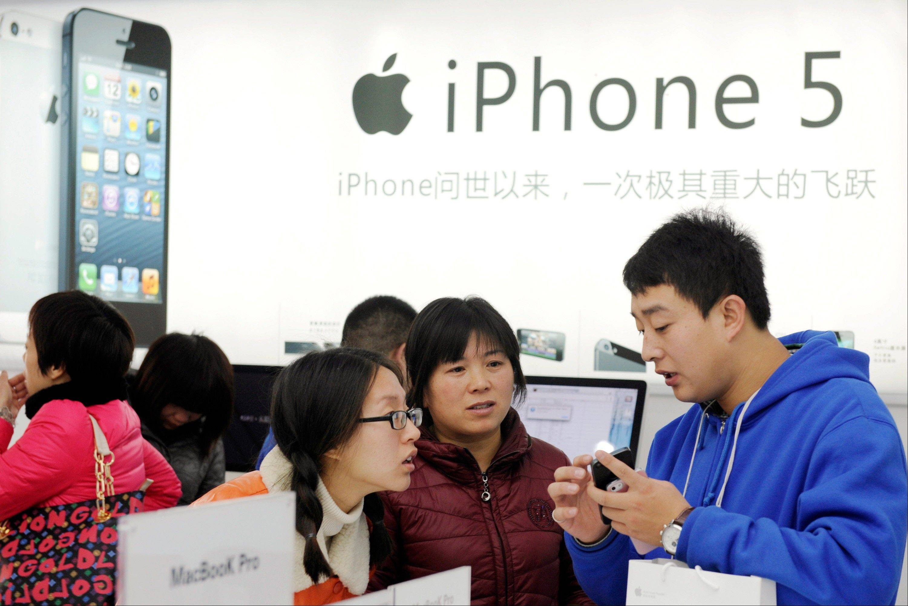 Apple Inc. shares dropped below $500, the first time since February, after the company was downgraded by Citigroup Inc. on concern that demand for the iPhone 5 model is slowing.