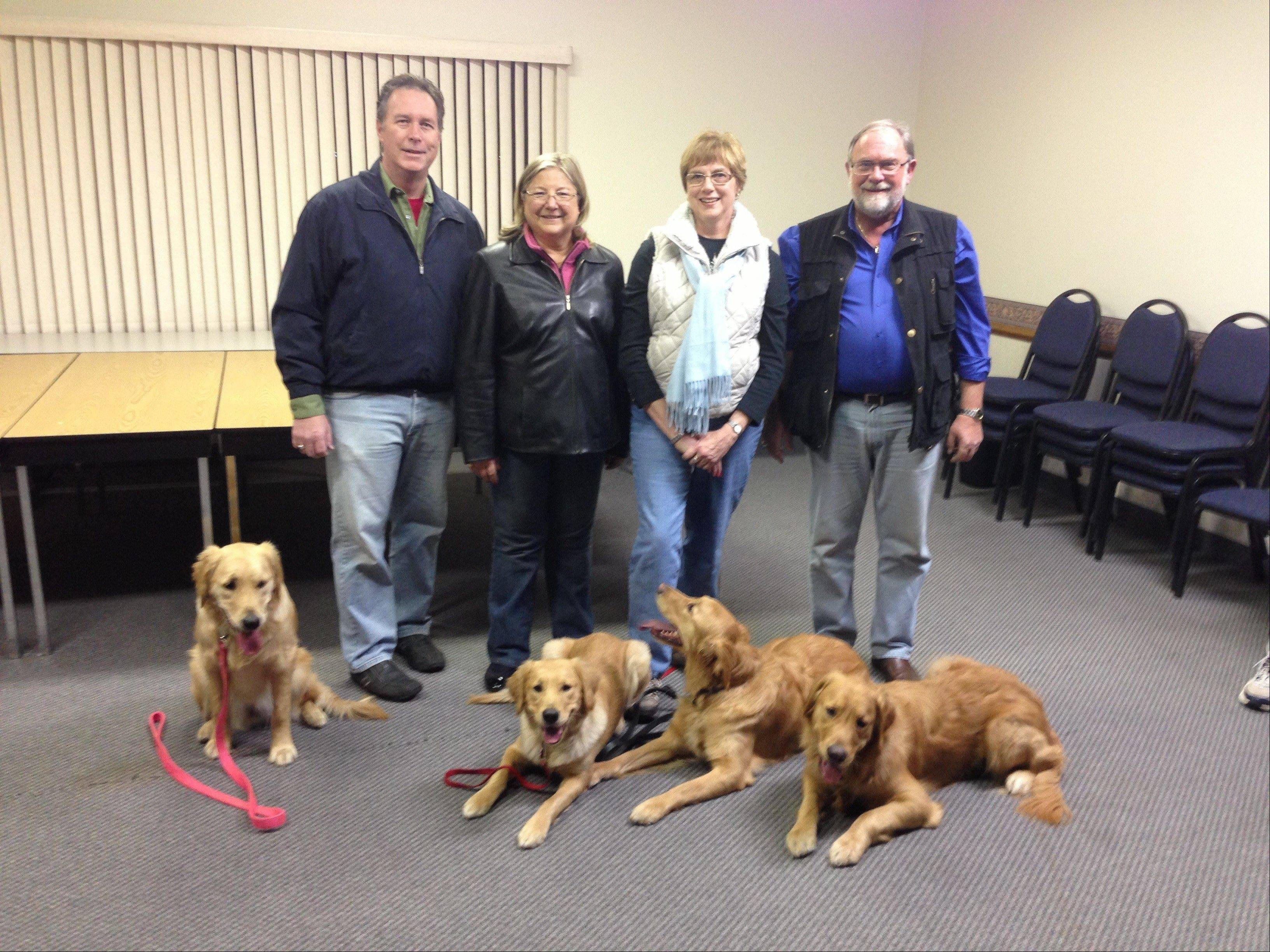Lutheran Church Charities staff members, pictured from left, Tim Kurth of Wheaton, Dona Martin of Lake Barrington, Lynn Buhrke of Palatine, and Tim Hetzner of Palatine arrived in Newtown, Conn. Saturday with their Comfort Dogs Ministry. The dogs, from left, are Zippy, Ruthie, Chewie and Luther.