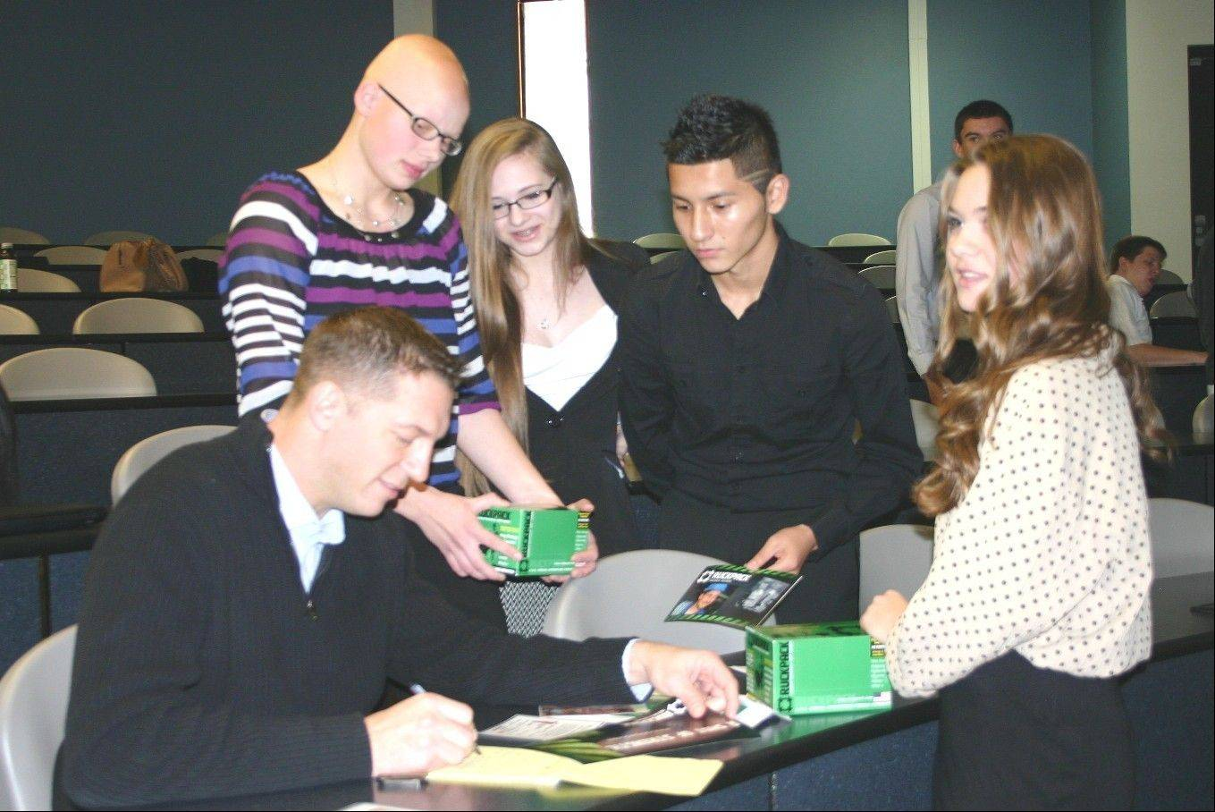 Rob Dyer, left, a Marine Corps veteran, entrepreneur and creator of the nutritional drink RuckPack, takes notes on ideas from Lake Park High School marketing students Sam Cummings, Sara Bobek, Mauricio Cardona and Cassidy McGinn. The students pitched marketing ideas for RuckPack to Dyer for their semester-end project.