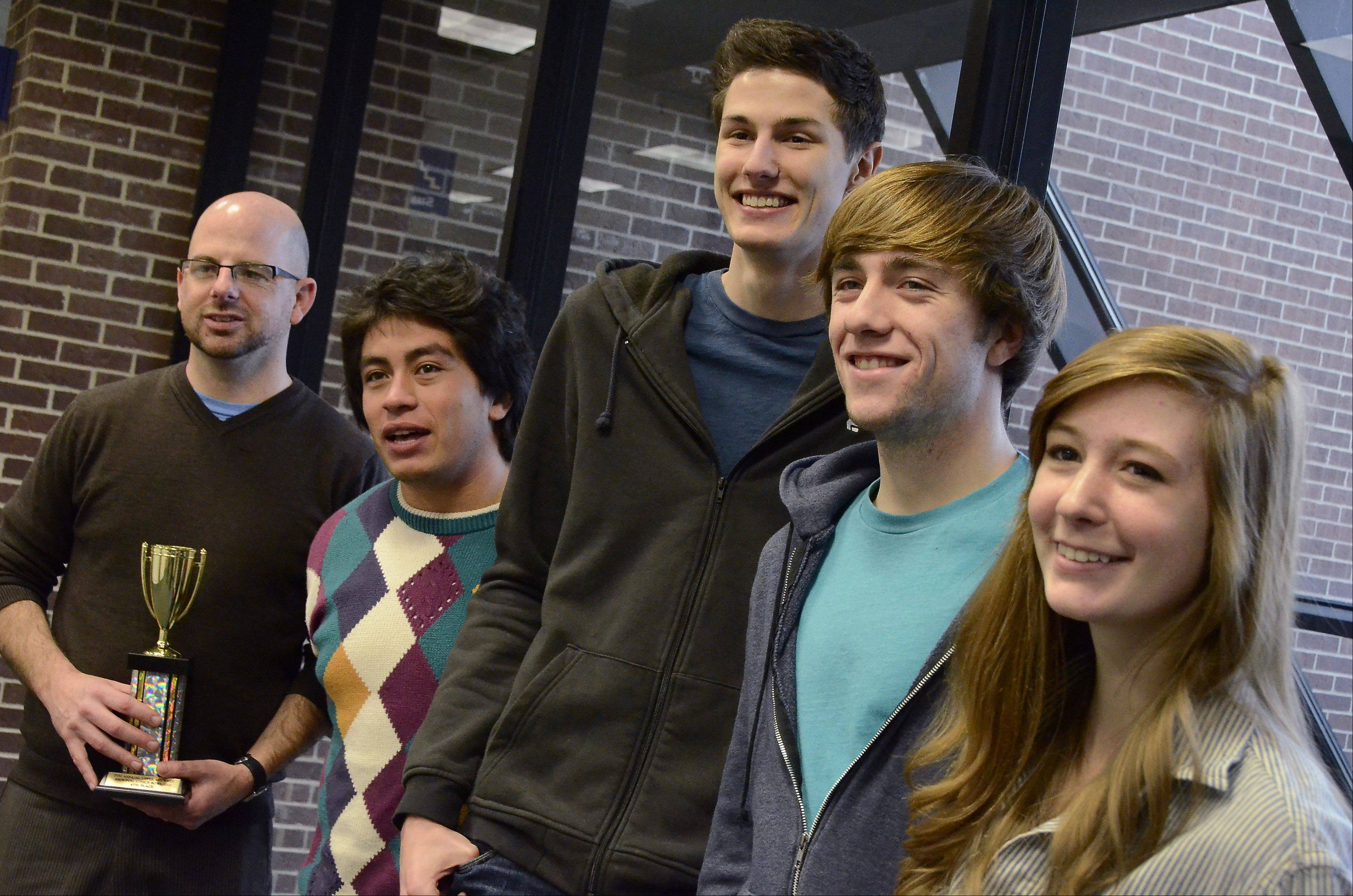 Harper College Ethics Bowl team members from left, Coach John Garcia, Gil Morquecho of Buffalo Grove, Eli Longbottom of Barrington, and Matt Sandel and Caitlin Weres.