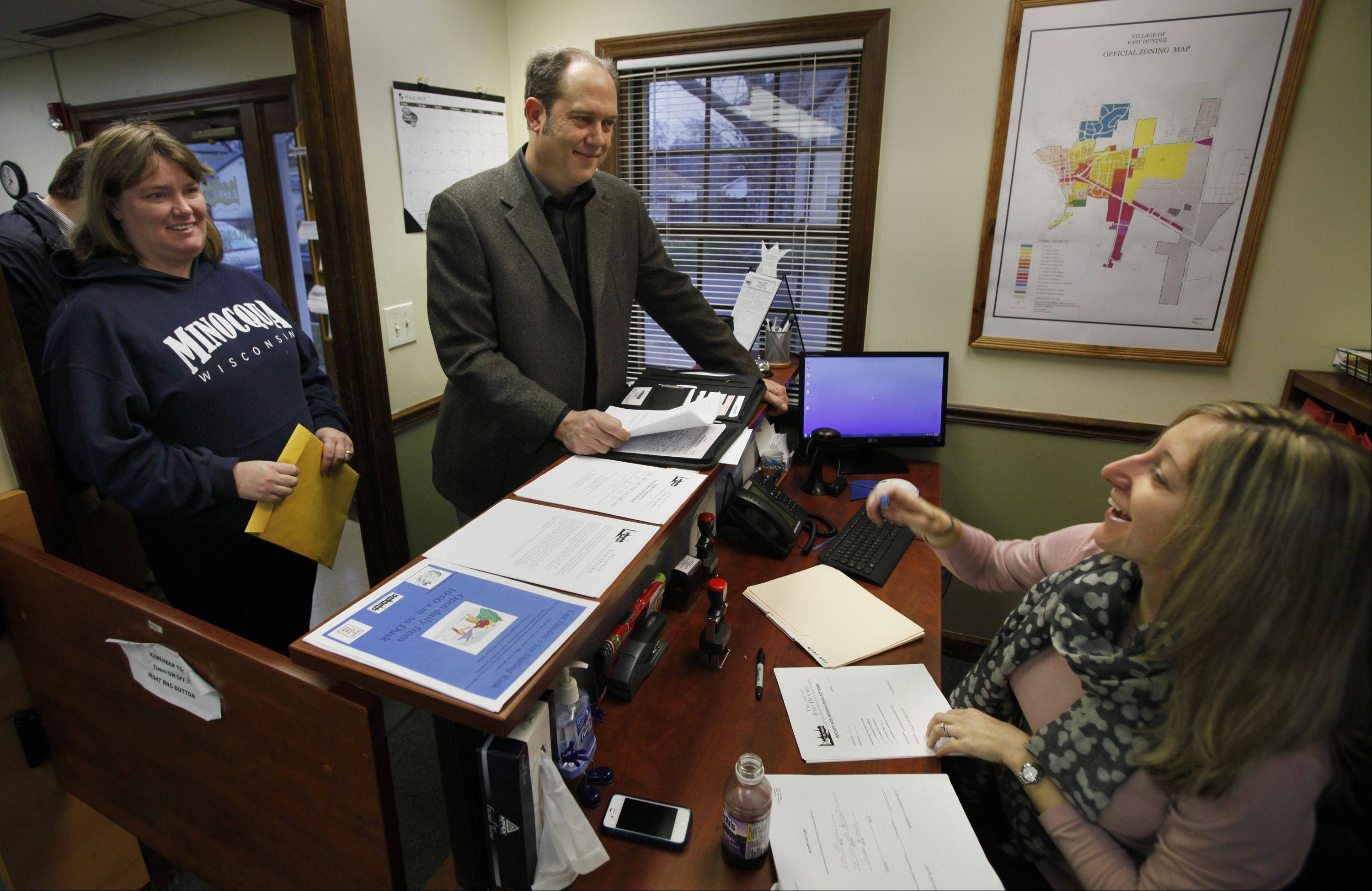 East Dundee Trustee Lael Miller was first in line Monday morning to file his paperwork for village president with Deputy Village Administrator Heather Maieritsch, who is also the acting village clerk. Waiting behind Miller is Kristi Selep who was dropping off paperwork for her husband, Dan, who is also running for trustee.
