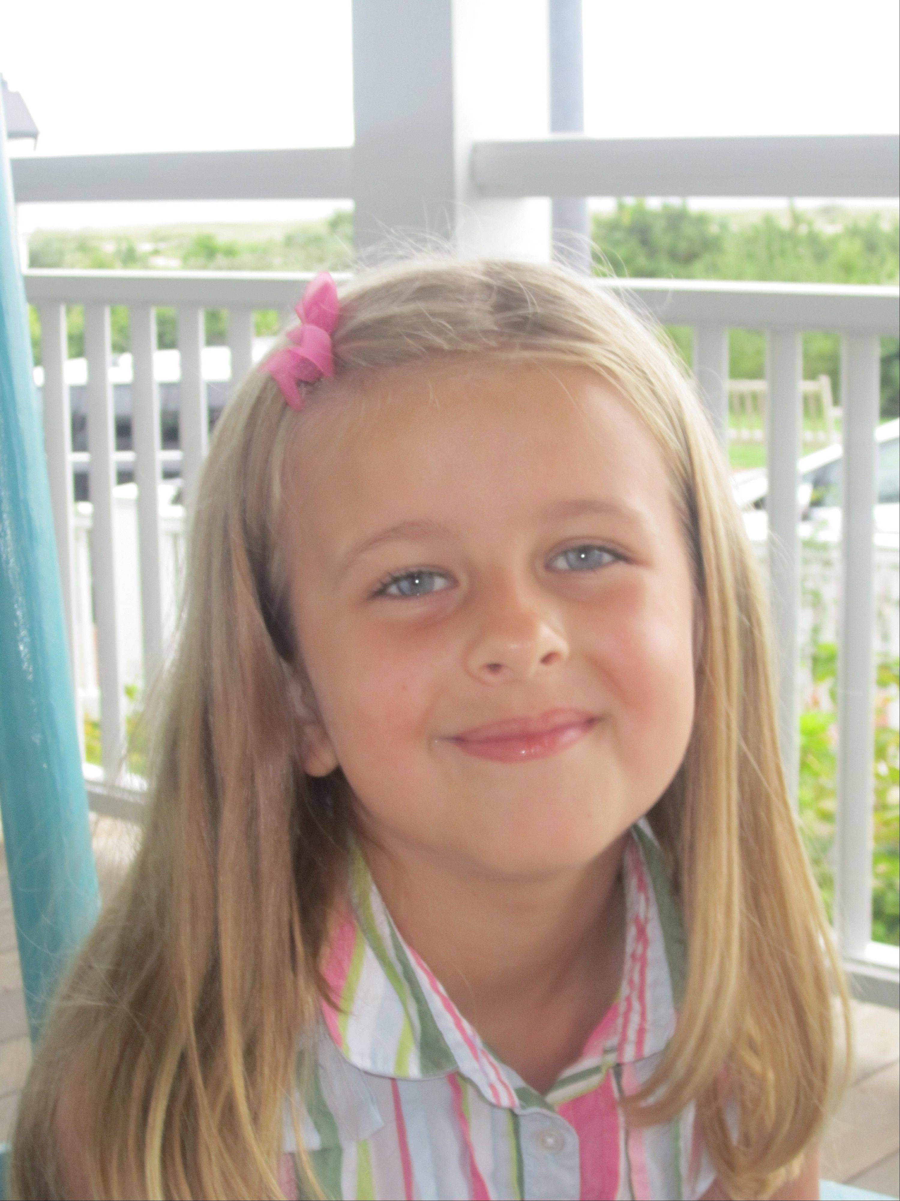 This image provided by the family shows Grace McDonnell posing for a portrait in this family photo taken Aug. 18, 2012. Grace McDonnell was killed Friday, Dec. 14, 2012, when a gunman opened fire at Sandy Hook elementary school in Newtown, Conn., killing 26 children and adults at the school.