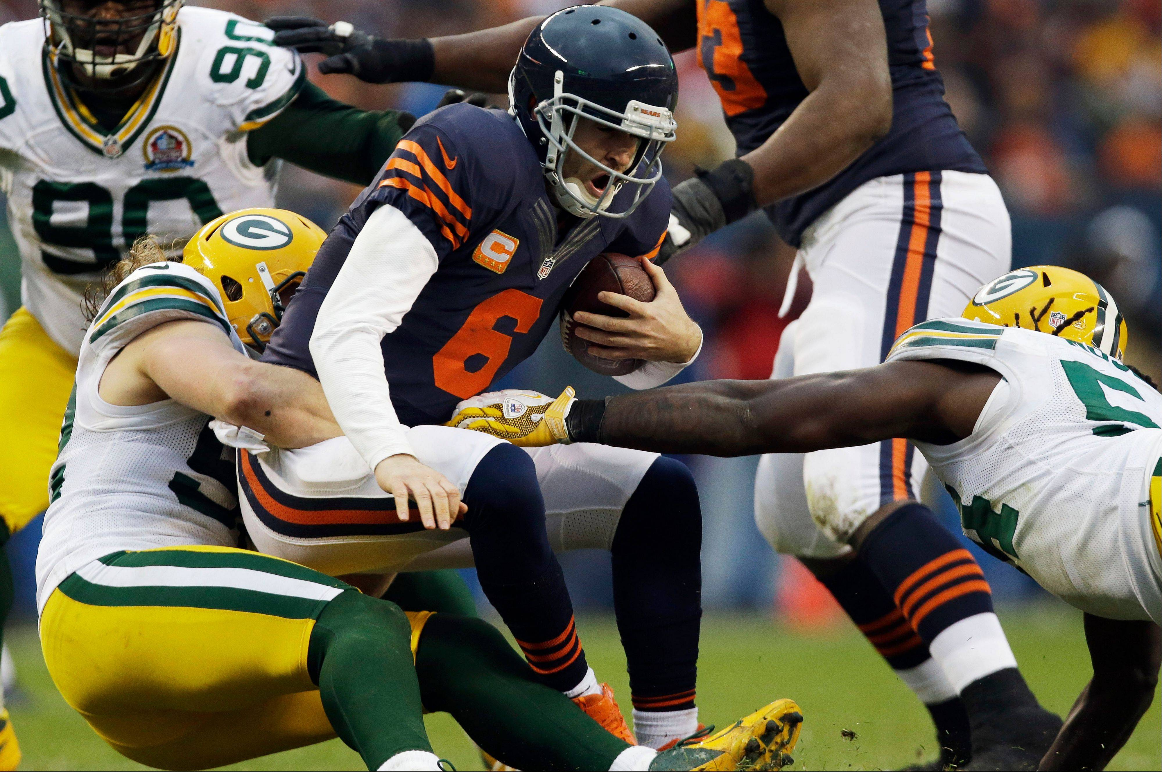 Chicago Bears quarterback Jay Cutler (6) is sacked by Green Bay Packers linebacker Clay Matthews, left, in the second half of an NFL football game in Chicago, Sunday, Dec. 16, 2012. At right is Packers linebacker Dezman Moses. The Packers won 21-13 to clinch the NFC North division title.