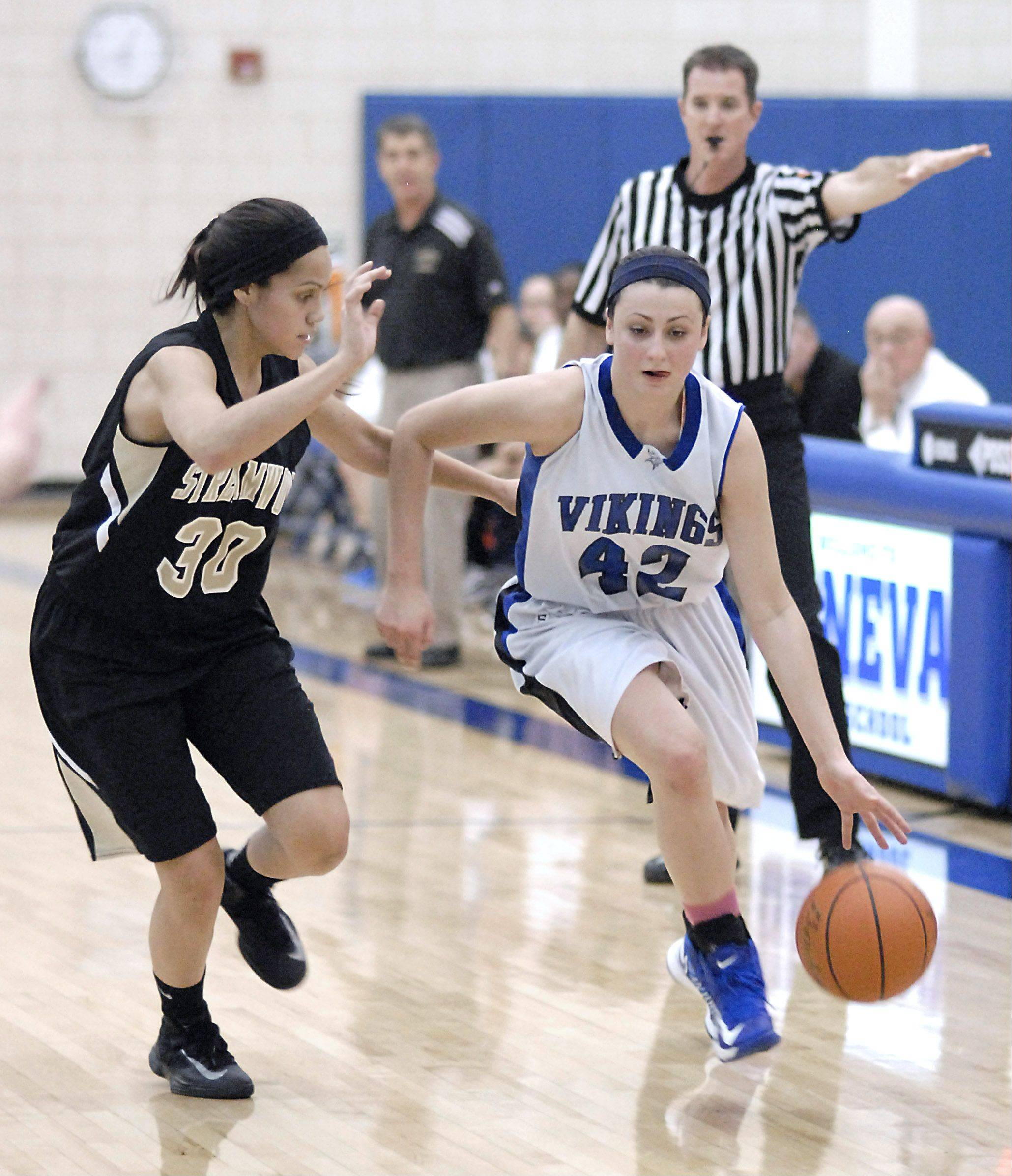 Streamwood senior Jessica Cerda, left, covers Geneva�s Abby Novak last week in Geneva. Cerda goes into the Sabres� game Wednesday night at Bartlett 17 points shy of 1,000 for her career.