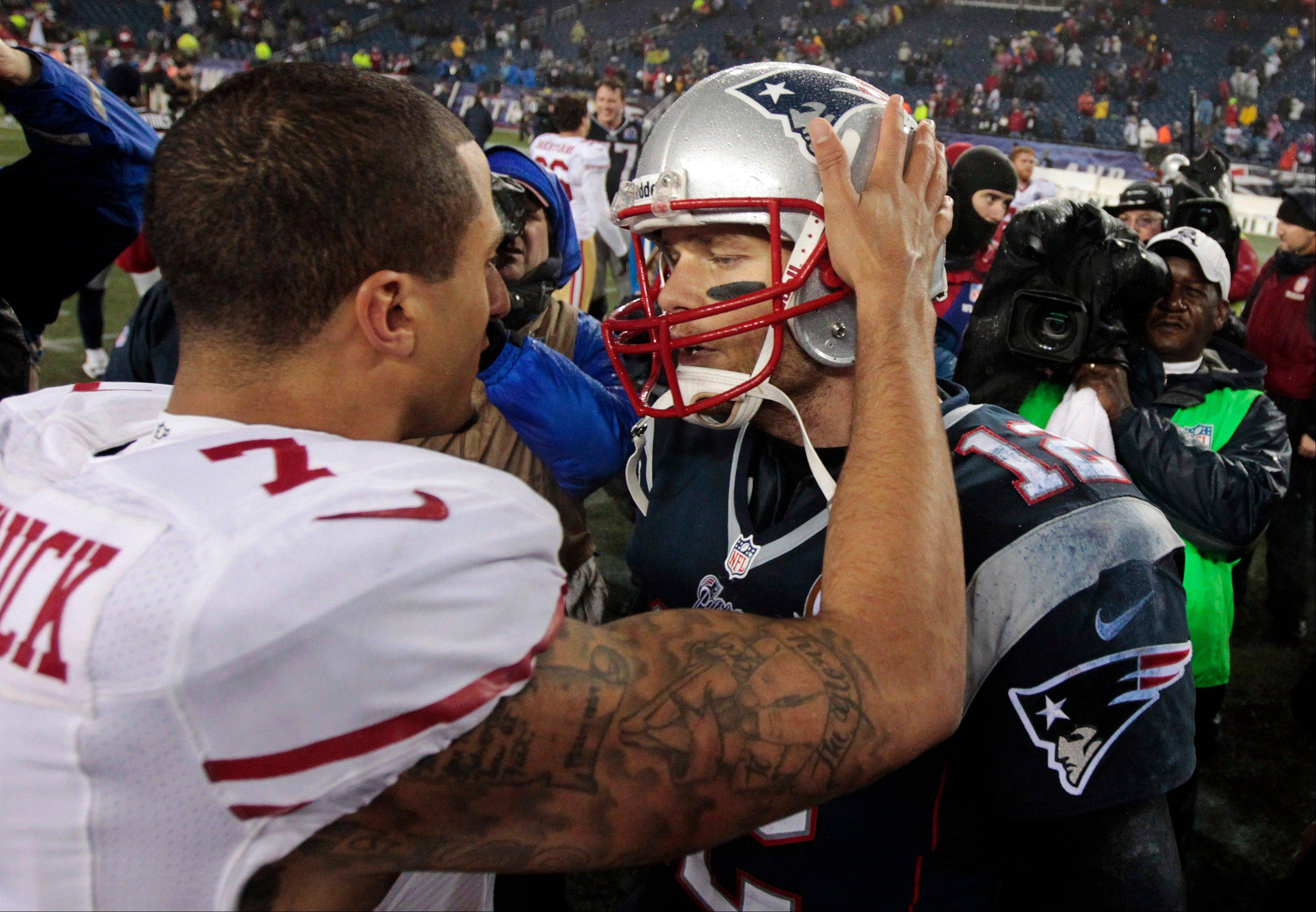 San Francisco 49ers quarterback Colin Kaepernick (7) and New England Patriots quarterback Tom Brady (12) meet at midfield after their game in Foxborough, Mass., Monday. The 49ers won 41-34.