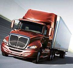 Lisle-based Navistar International said Monday it has started shipping the first commercial trucks with EPA-compliant diesel engines built by Cummins Inc.