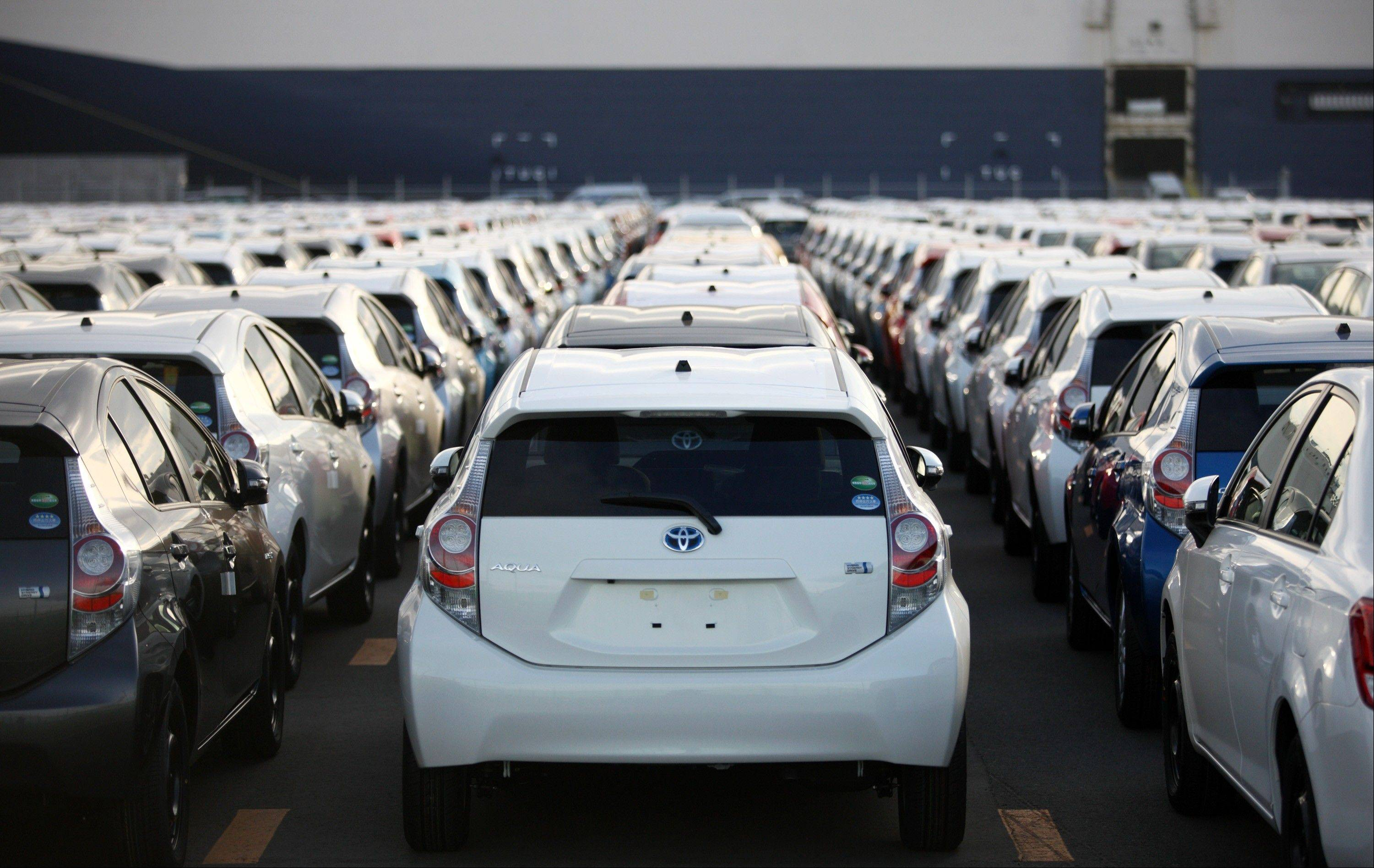 Toyota Motor Corp. is poised to take back the title of world's biggest automaker for 2012, as Volkswagen AG fights General Motors Co. for second place heading into the final weeks.