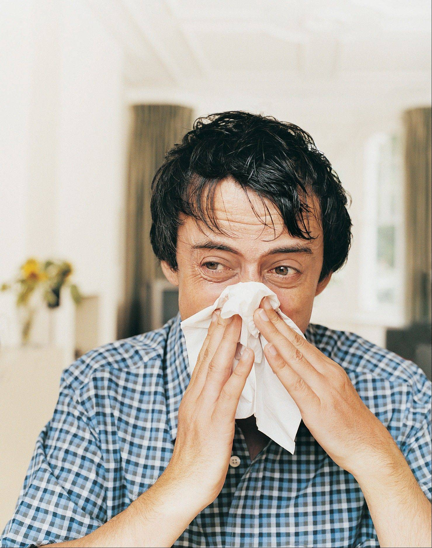 Health experts recommend staying home if you're sick instead of going into the office.