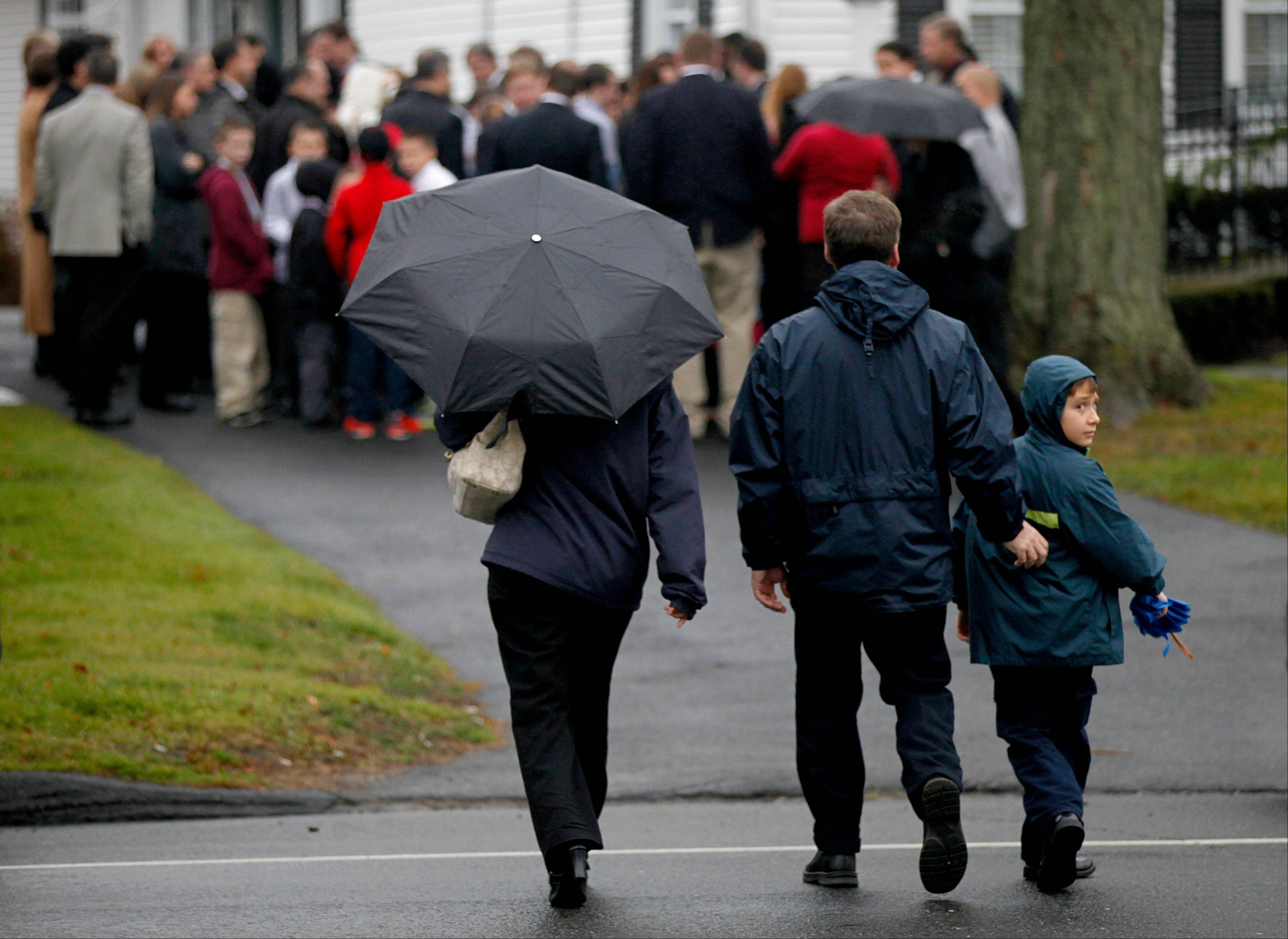 Mourners arrive for the funeral service for 6-year-old Jack Pinto, Monday, Dec. 17, 2012 in Newtown, Conn. Pinto was killed when a gunman walked into Sandy Hook Elementary School in Newtown Friday and opened fire, killing 26 people, including 20 children.