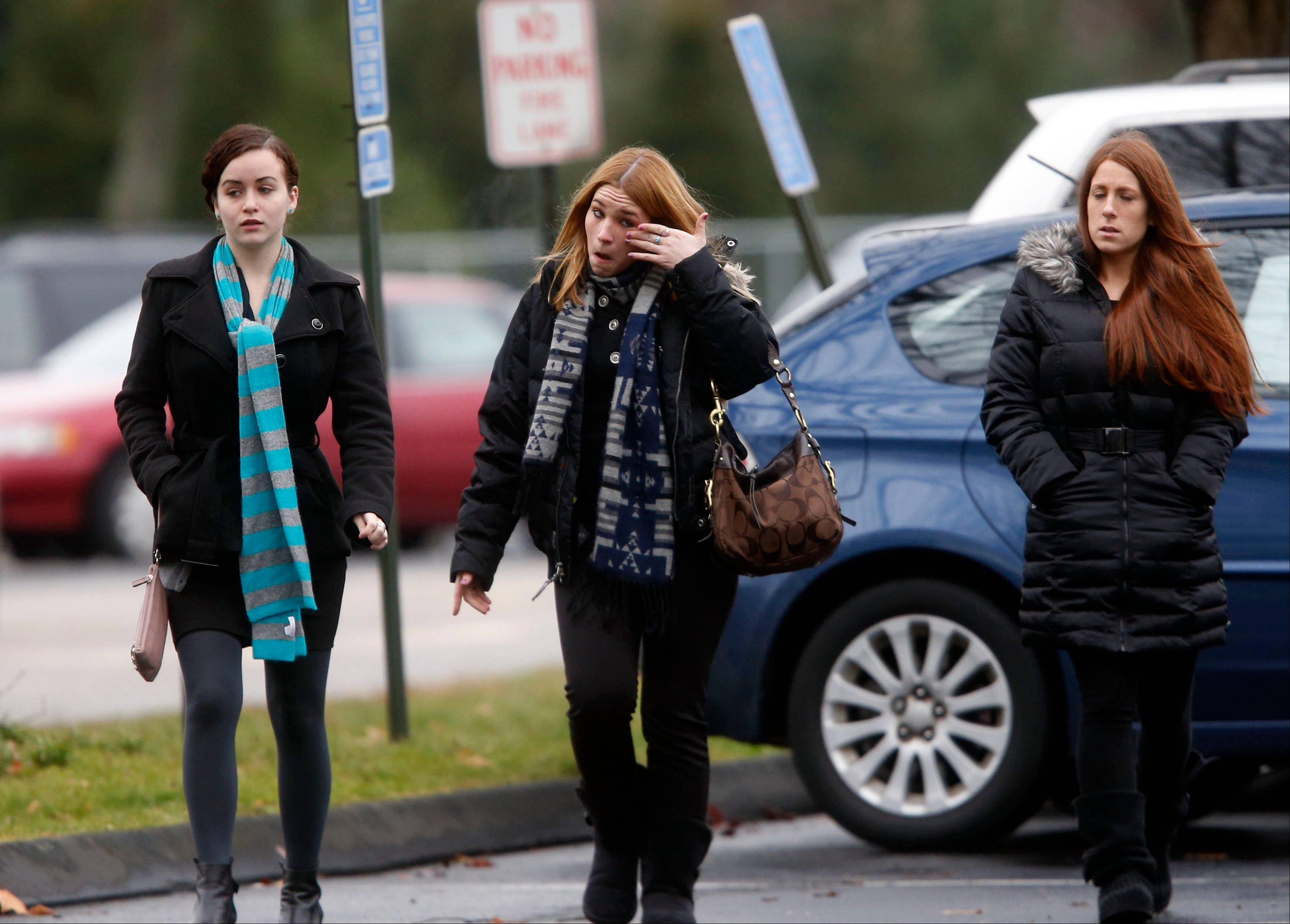 Mourners arrive at a funeral service for 6-year-old Noah Pozner, Monday, Dec. 17, 2012, in Fairfield, Conn. Pozner was killed when a gunman walked into Sandy Hook Elementary School in Newtown Friday and opened fire, killing 26 people, including 20 children.