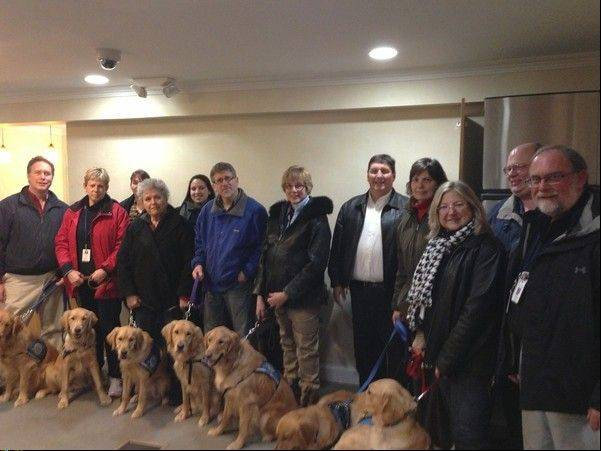 A group from Addison-based Lutheran Church Charities' Comfort Dogs Ministry arrived in Newtown, Conn., Saturday and have been bringing their dogs to different vigils and schools to provide comfort in the wake of the school shootings.