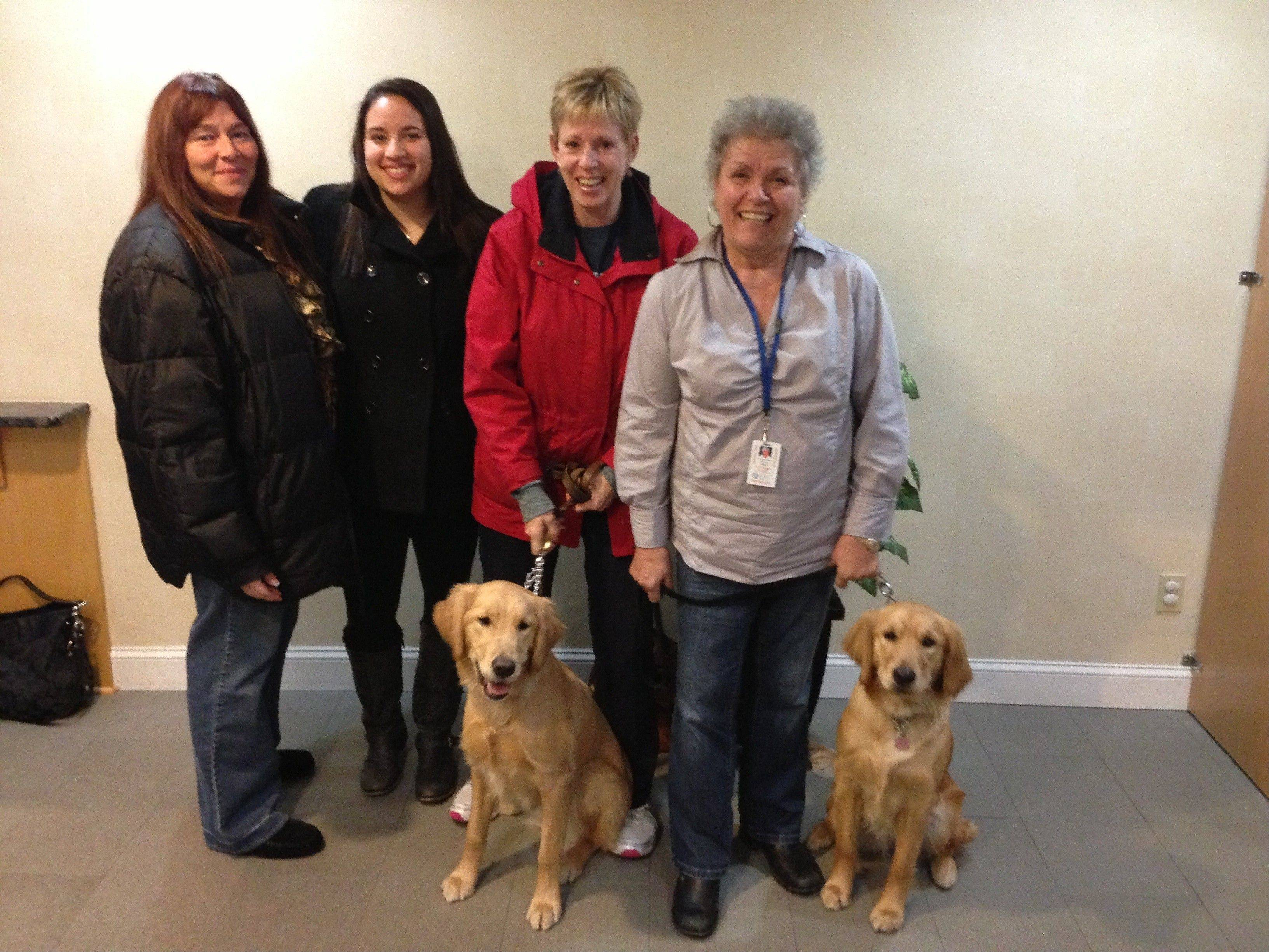 Marcy and Lacey Brooks, of Des Plaines, Barb Granado of Arlington Heights (with dog Hannah), and Sharon Flaherty of Arlington Heights (with dog Maggie), arrive in Newtown, Conn., to help Lutheran Church Charities' Comfort Dog Ministry.