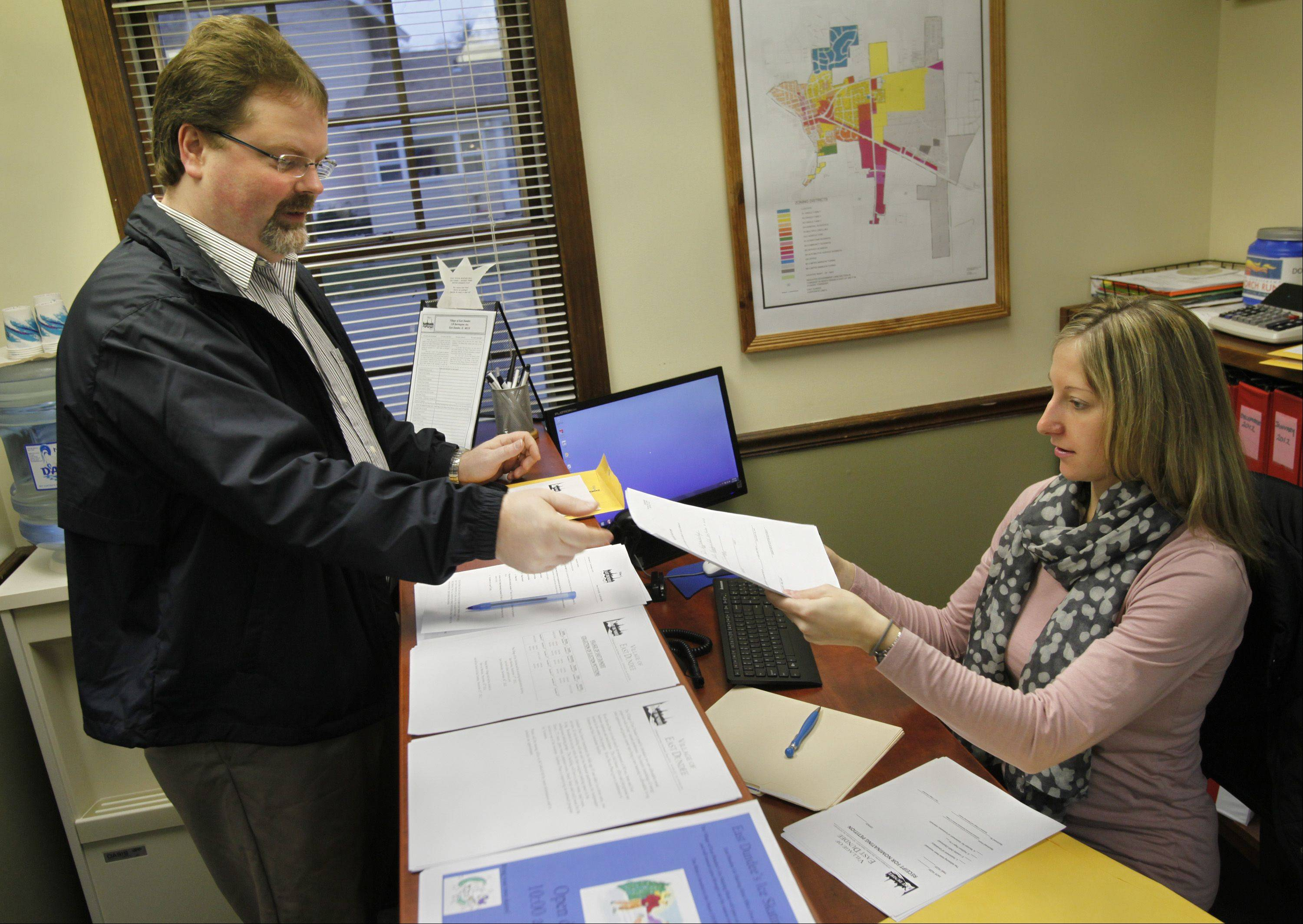 East Dundee Village President Jerald Bartels files his election paperwork with Deputy Village Administrator Heather Maieritsch, who is also the acting village clerk. Bartels also submitted materials for Trustee Paul VanOstenbridge, who was out of town.