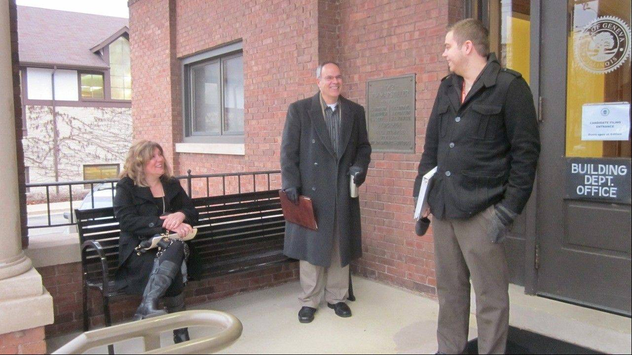 Geneva Alderman Dawn Vogelsberg, Michael Bruno and Zachary Ploppert wait for city hall to open Monday to file their petitions for the April election. Vogelsberg is running or the 3rd Ward seat; Bruno and Ploppert, the 1st Ward seat.