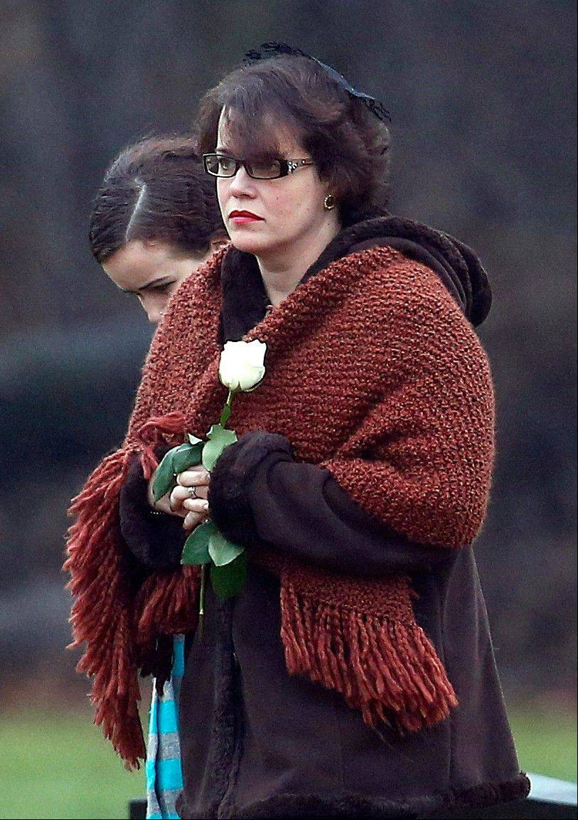 Veronique Pozner arrives at B'nai Israel Cemetery in Monroe, Conn., for burial services Monday for her 6-year-old son Noah Pozner, who was killed Friday in the shootings at Sandy Hook Elementary School in Newtown.
