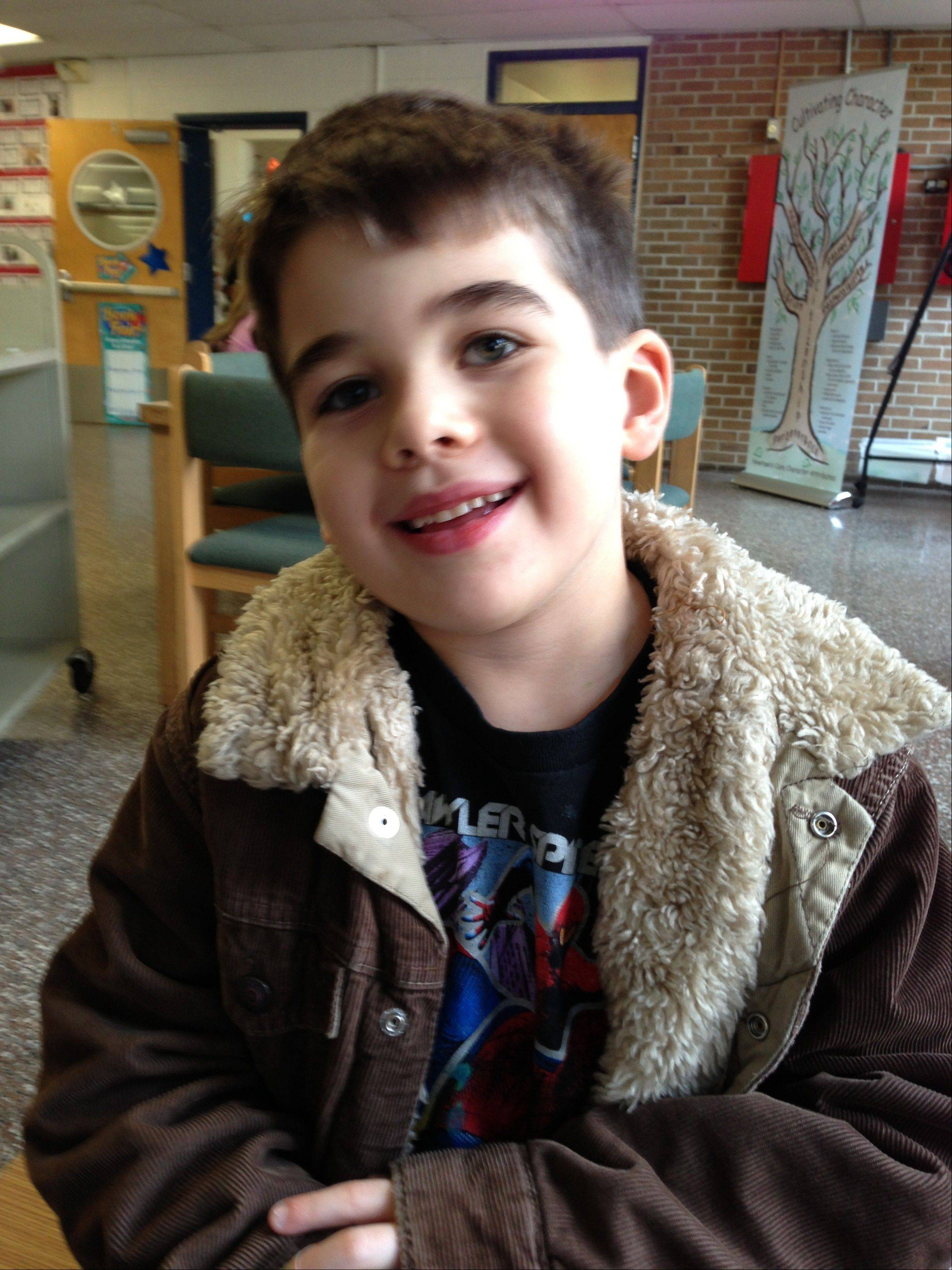 This Nov. 13, 2012 photo provided by the family via The Washington Post shows Noah Pozner. The six-year-old was one of the victims in the Sandy Hook elementary school shooting in Newtown, Conn. on Dec. 14, 2012. Noah will be buried today.