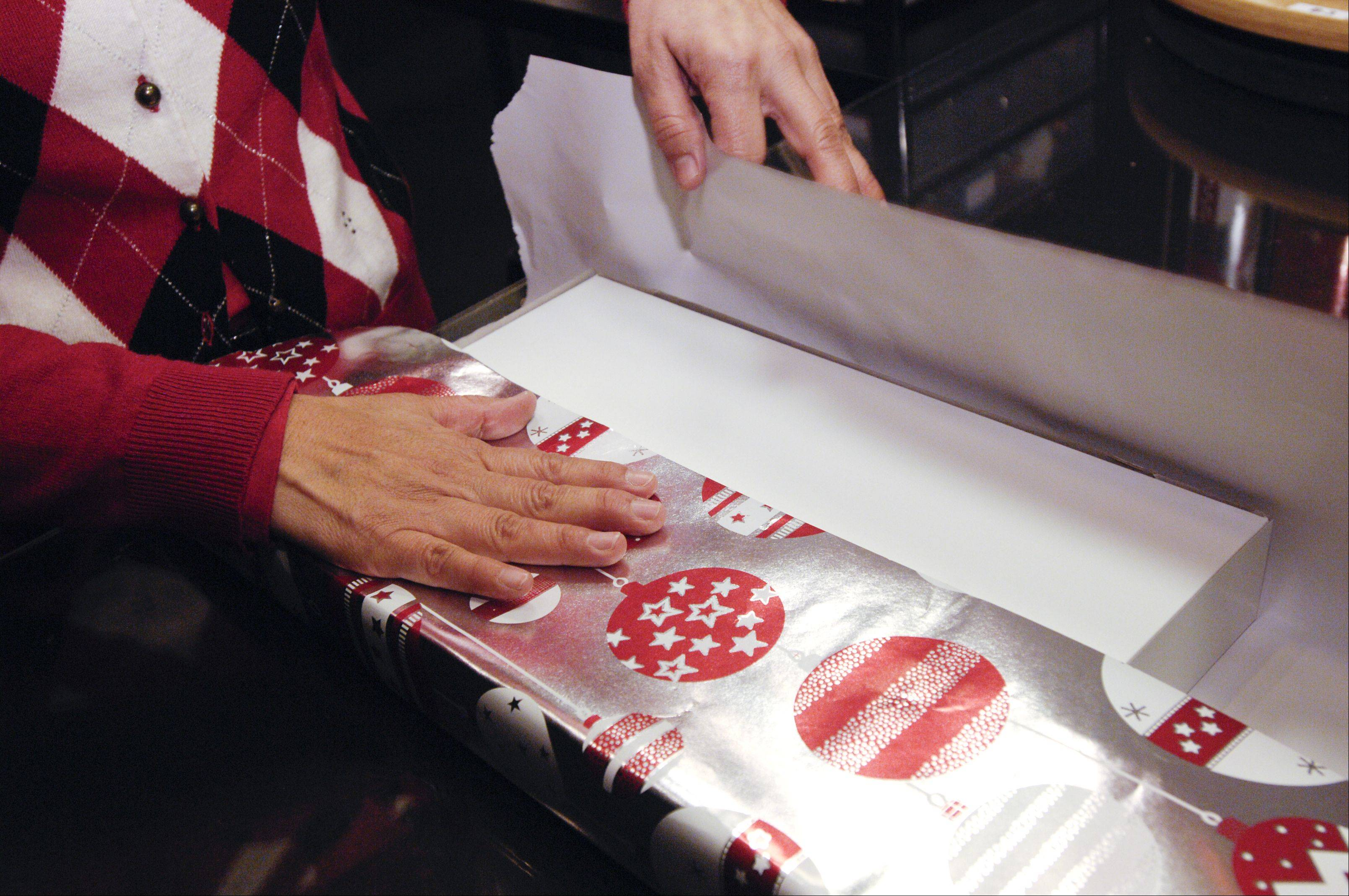 Step 1: Determine how much wrapping paper to use by folding an unsecured side to the center of the box.