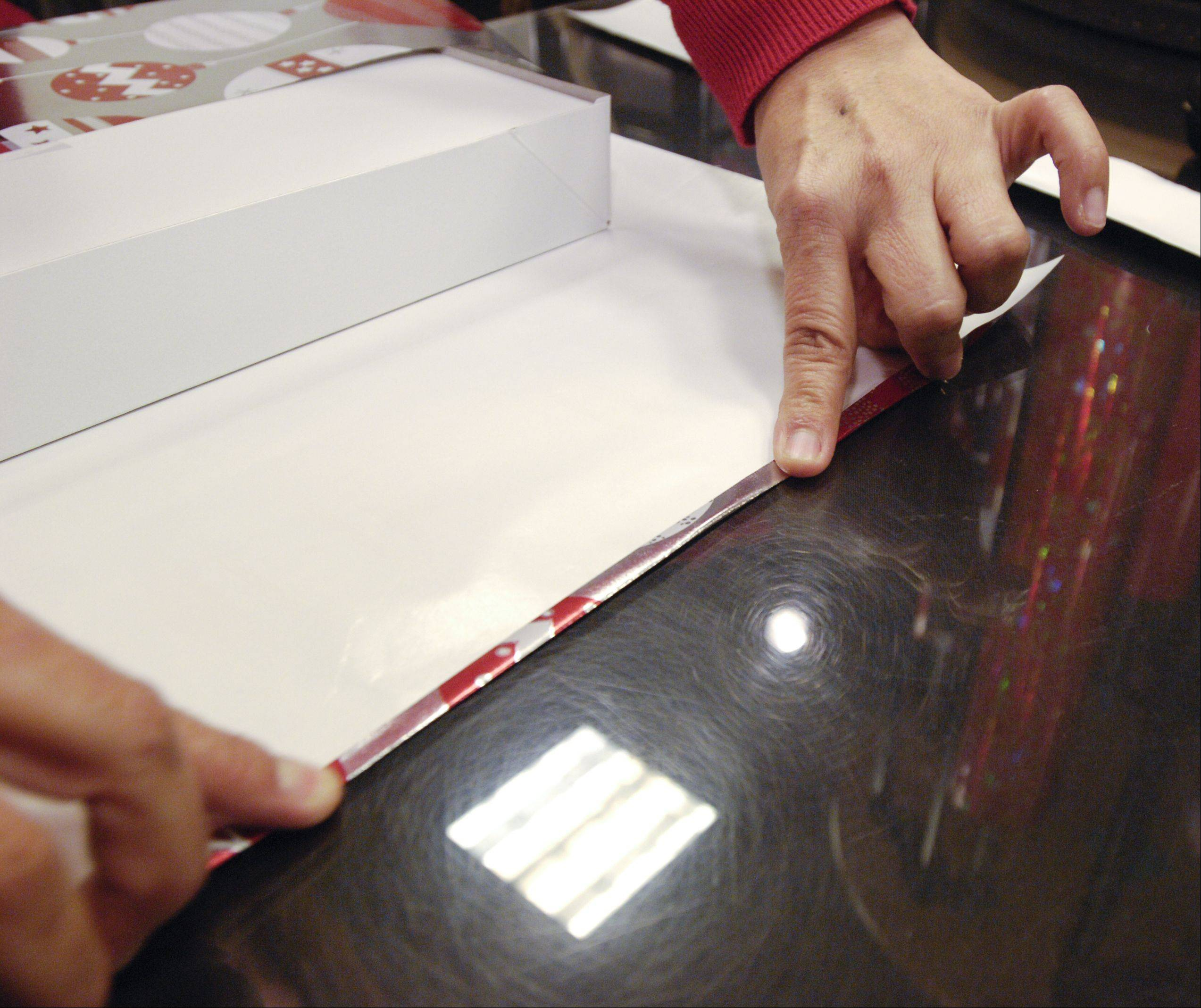 Step 4: Fold the edge of the wrapping paper for crisp lines.