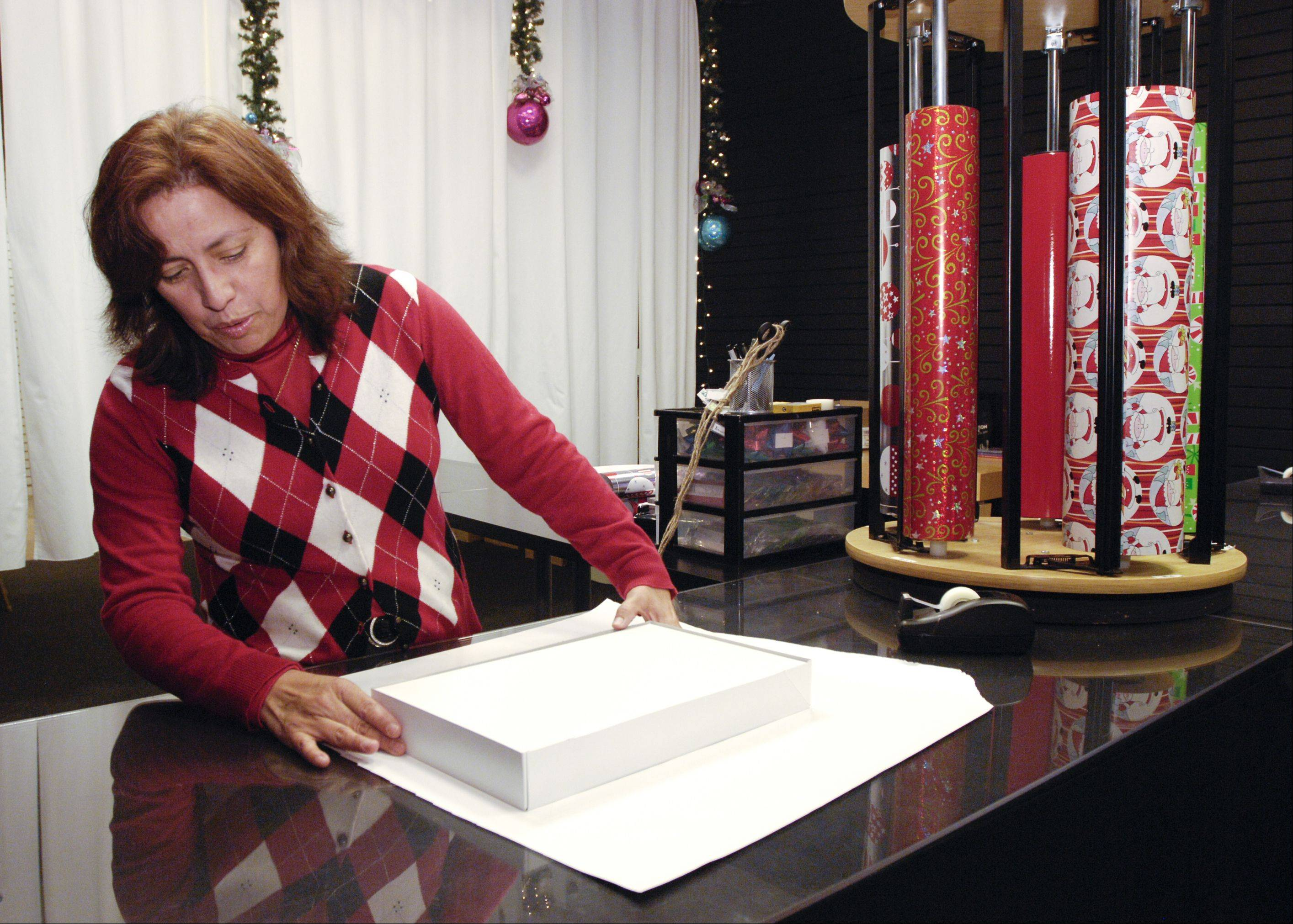Lilly Grimm, who volunteers at Oakbrook Center's gift wrapping station, brings a unique approach -- and some real speed -- to her task.