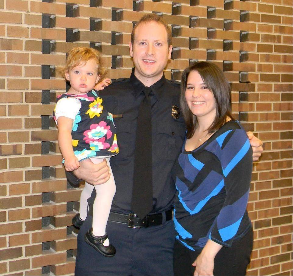 Hundreds gathered Sunday for a fundraiser for Schaumburg firefighter Mike Solberg, who recently underwent surgery as part of his battle with brain cancer. Solberg is with his wife, Maureen, and their 21-month-old daughter, Emma.