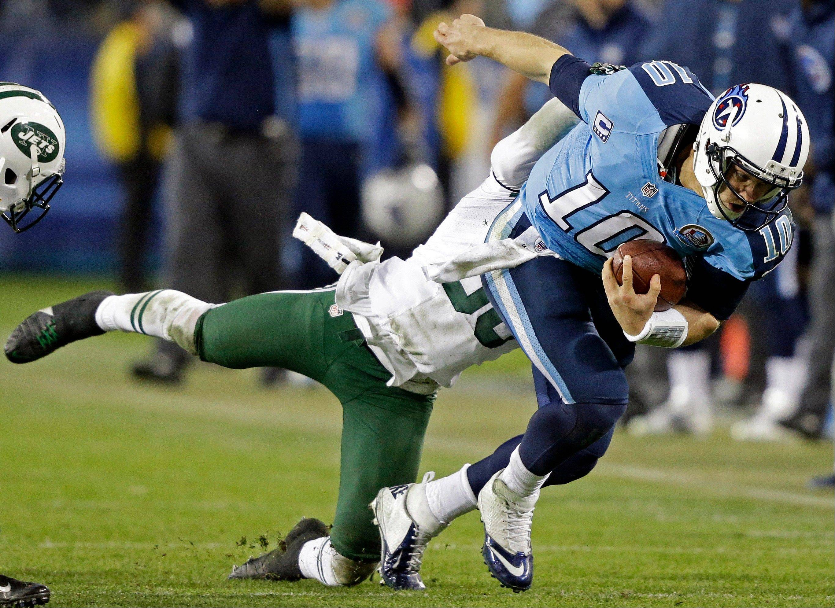 Tennessee Titans quarterback Jake Locker (10) is tackled by New York Jets free safety LaRon Landry (30) in the third quarter of an NFL football game, Monday, Dec. 17, 2012, in Nashville, Tenn.