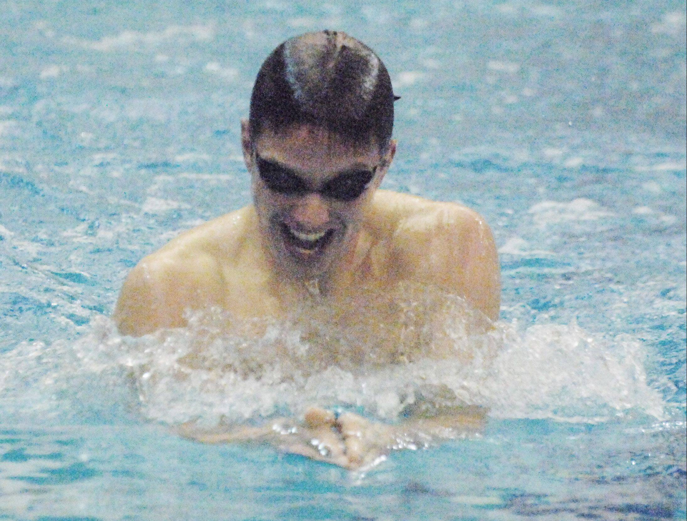 TJ Bindseil of St. Charles East swims the 200 IM during the Neuqua Valley boys swimming invitational Saturday.