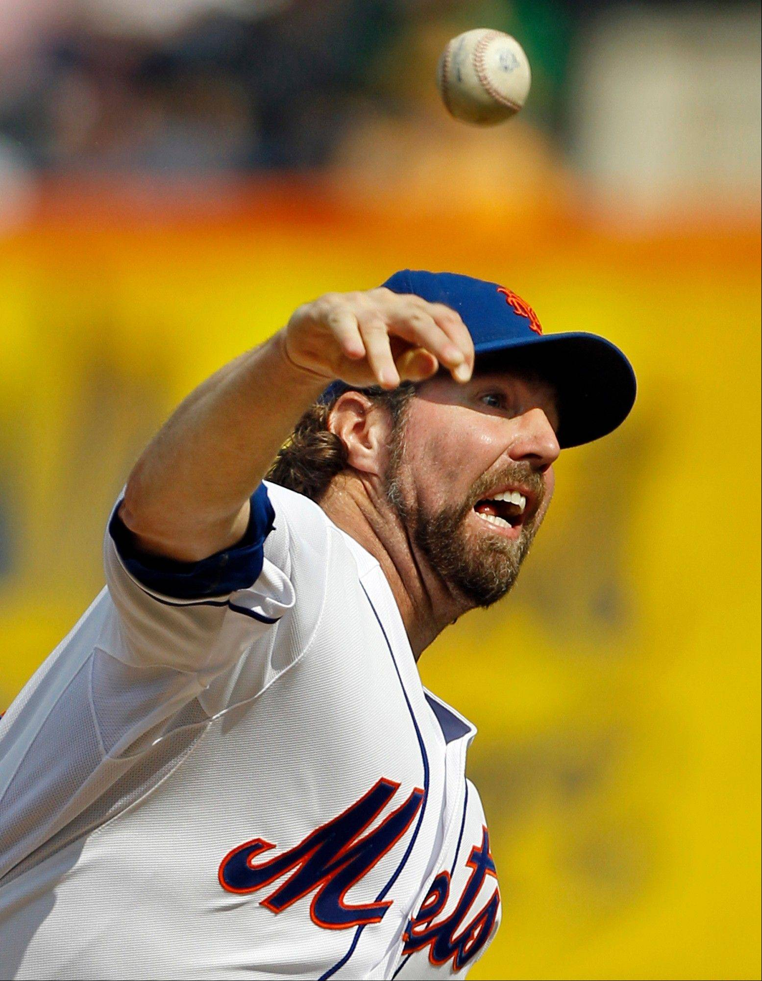 In this Sept. 27, 2012, file photo, New York Mets starting pitcher R.A. Dickey delivers against the Pittsburgh Pirates during the first inning of a baseball game at Citi Field in New York. Dickey and Mets general manager Sandy Alderson can agree on one thing _ they would prefer to have closure before opening day. The Cy Young Award winner can become a free agent after the 2013 season and says he won't negotiate once it starts, so the Mets probably have to sign him to an extension or trade him to get the best return.