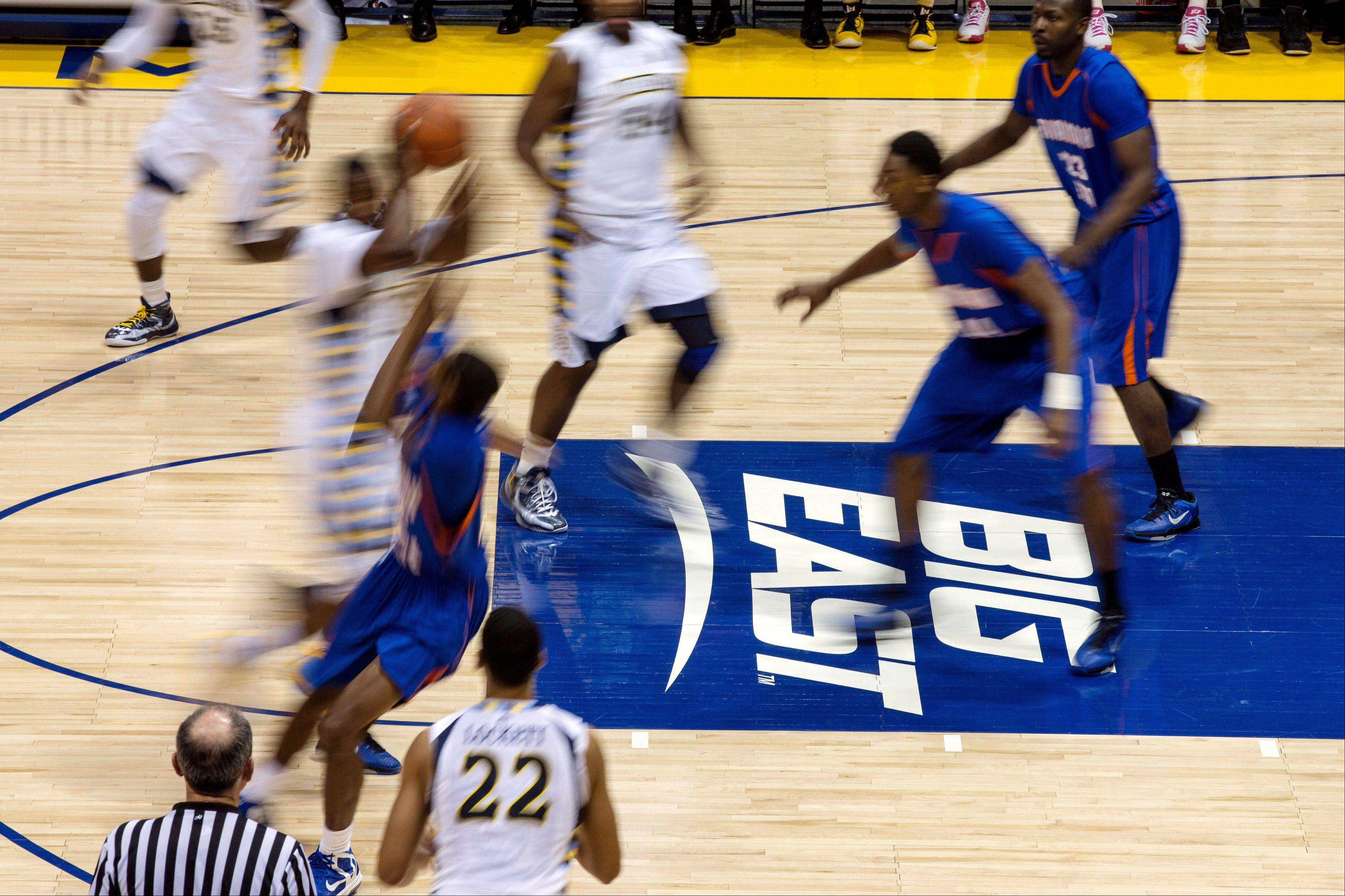 In this Dec. 15, 2012, file photo, Marquette plays against Savannah State during the second half of an NCAA college basketball game in Milwaukee. As a chunk of the Big East, Marquette included, transforms itself into a mostly or even all-Catholic basketball league, the conference faces a choice: play up or play down its faith-based roots?