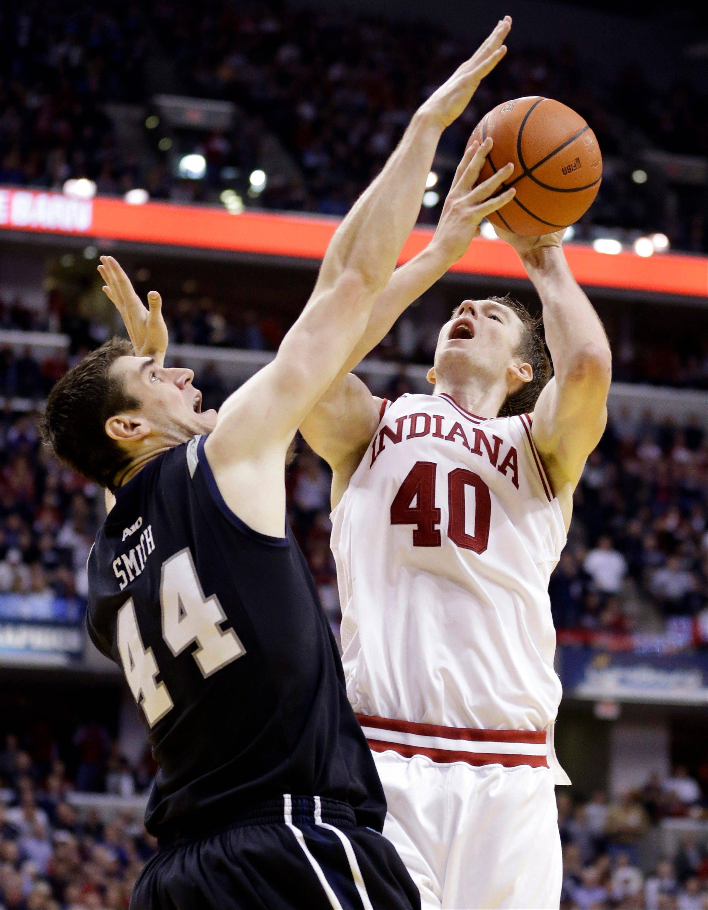 Indiana forward Cody Zeller, right, shoots over Butler center Andrew Smith in the second half of an NCAA college basketball game in Indianapolis on Saturday. Butler defeated Indiana 88-86 in overtime. Indiana's loss means Duke takes the top spot in the AP poll.
