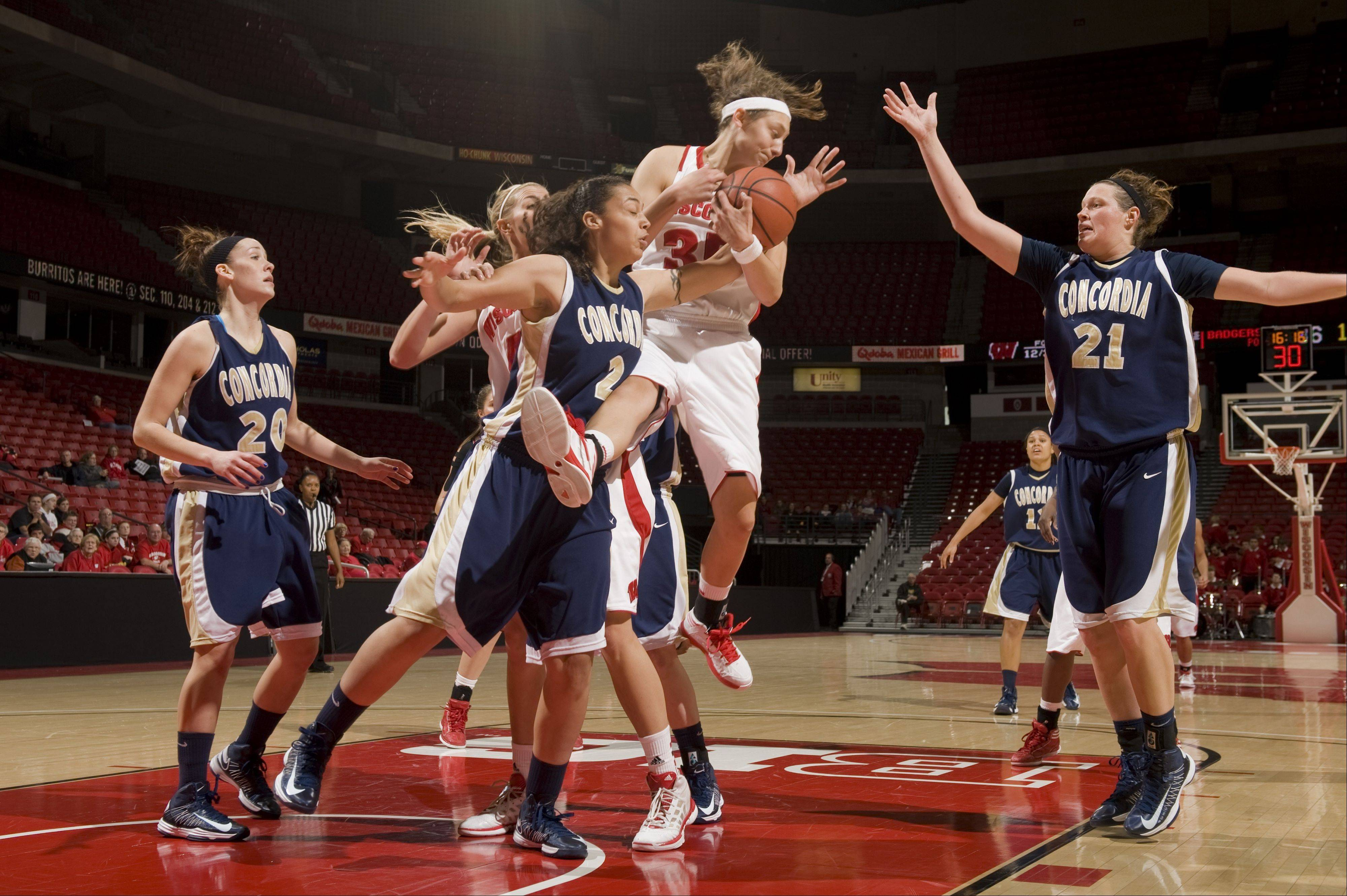 Former Bartlett High School basketball star Jacki Gulczynski, shown here grabbing a rebound against Concordia, was named Big Ten Player of the Week after averageing 20 points and 12 rebounds in a pair of games last week.