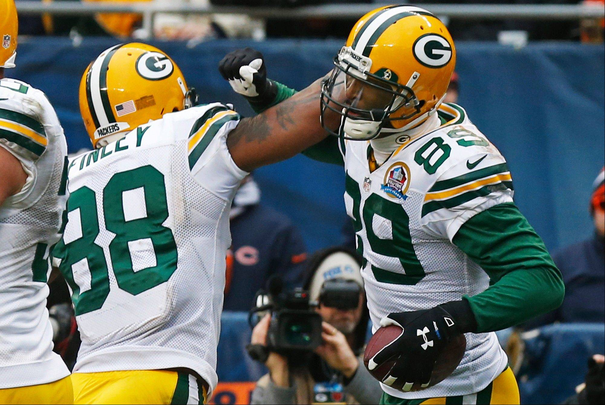 Green Bay Packers wide receiver James Jones (89) celebrates his touchdown reception with teammate Jermichael Finley (88) in the second half of an NFL football game in Chicago, Sunday, Dec. 16, 2012.