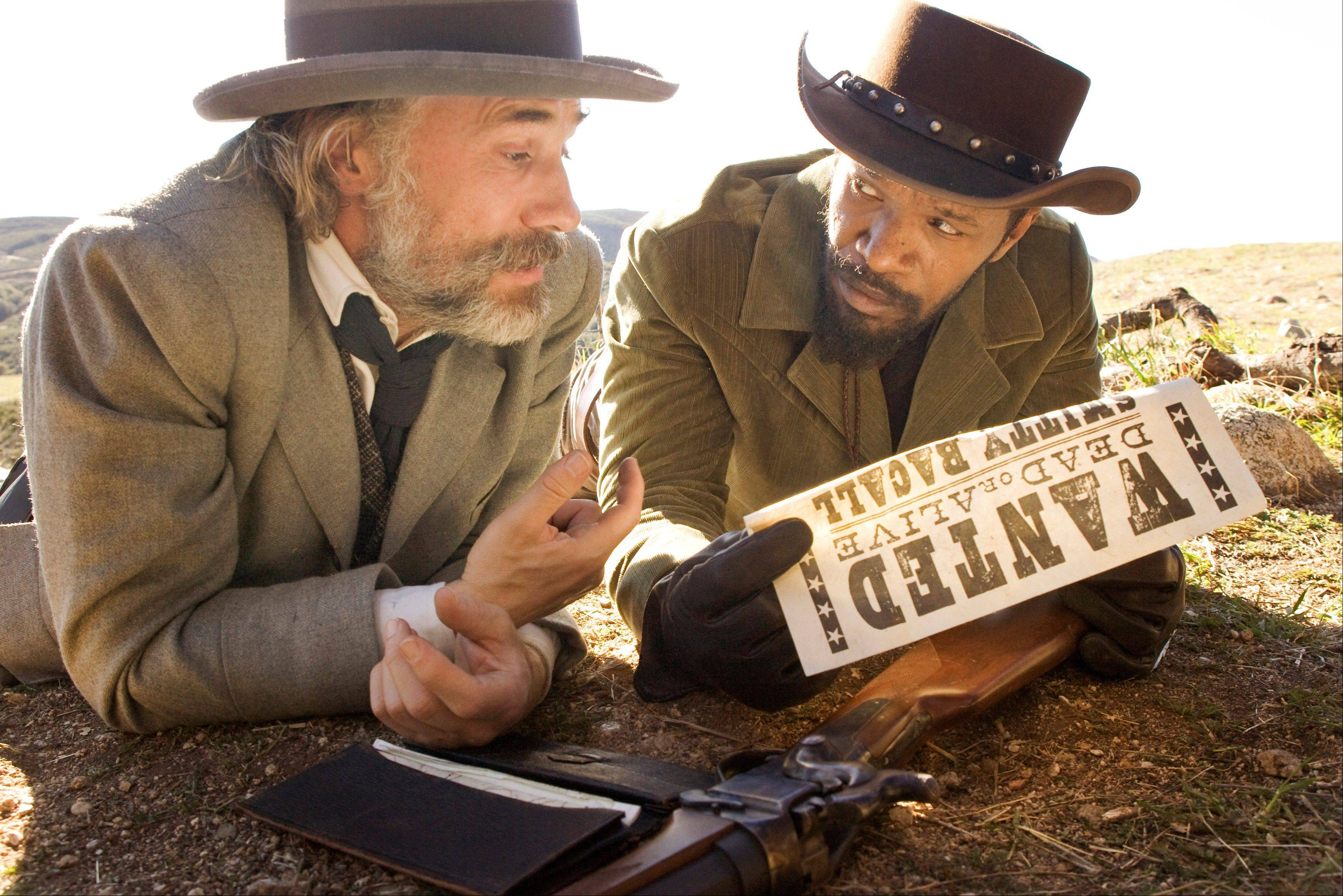 Christoph Waltz as Schultz, left, and Jamie Foxx as Django in the film, �Django Unchained,� directed by Quentin Tarantino. Foxx says Hollywood should take some responsibility for tragedies such as the deadly school shooting in Connecticut last week.