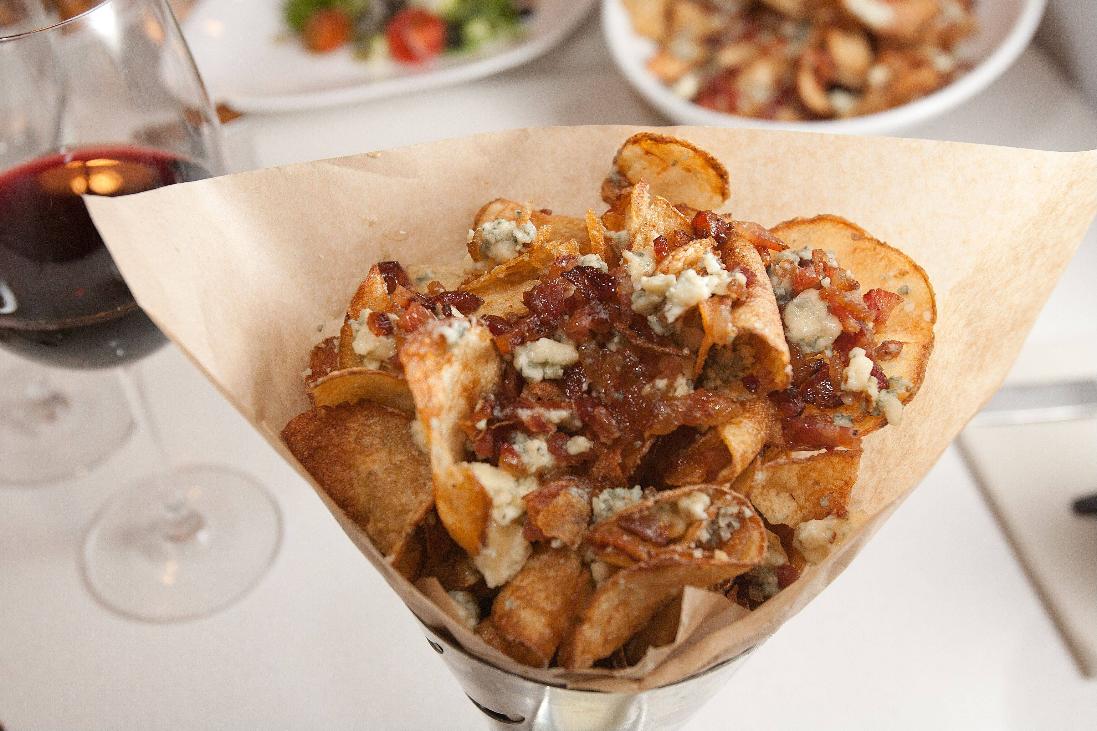 Artisan Table's house-made chips come topped with crumbled blue cheese and caramelized bacon.