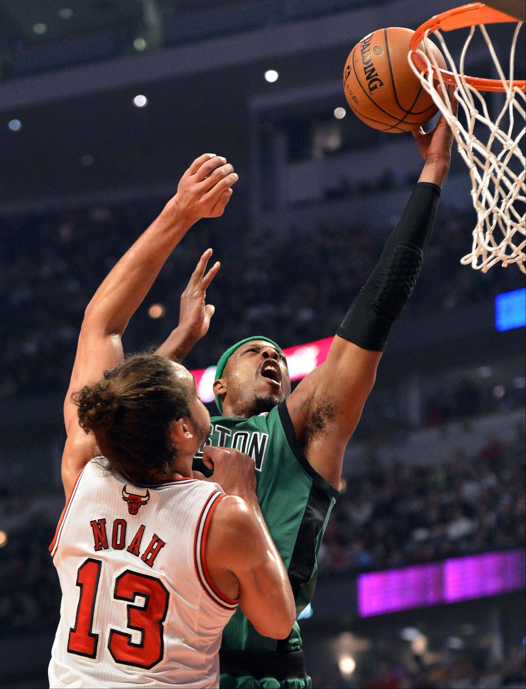 Bulls center Joakim Noah defends the Celtics� Paul Pierce as Pierce goes up for a layup Tuesday night. Noah finished with 11 points, 13 rebounds and 10 assists.