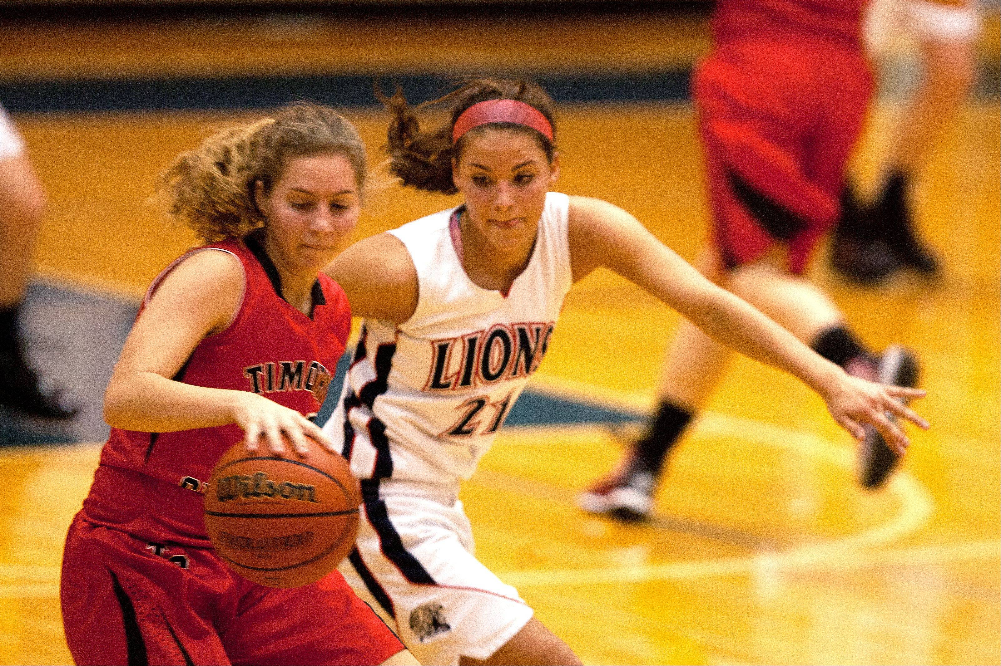 Timothy Christian�s Sara Hodges, left, moves past Lisle�s Kelly Urban, right.