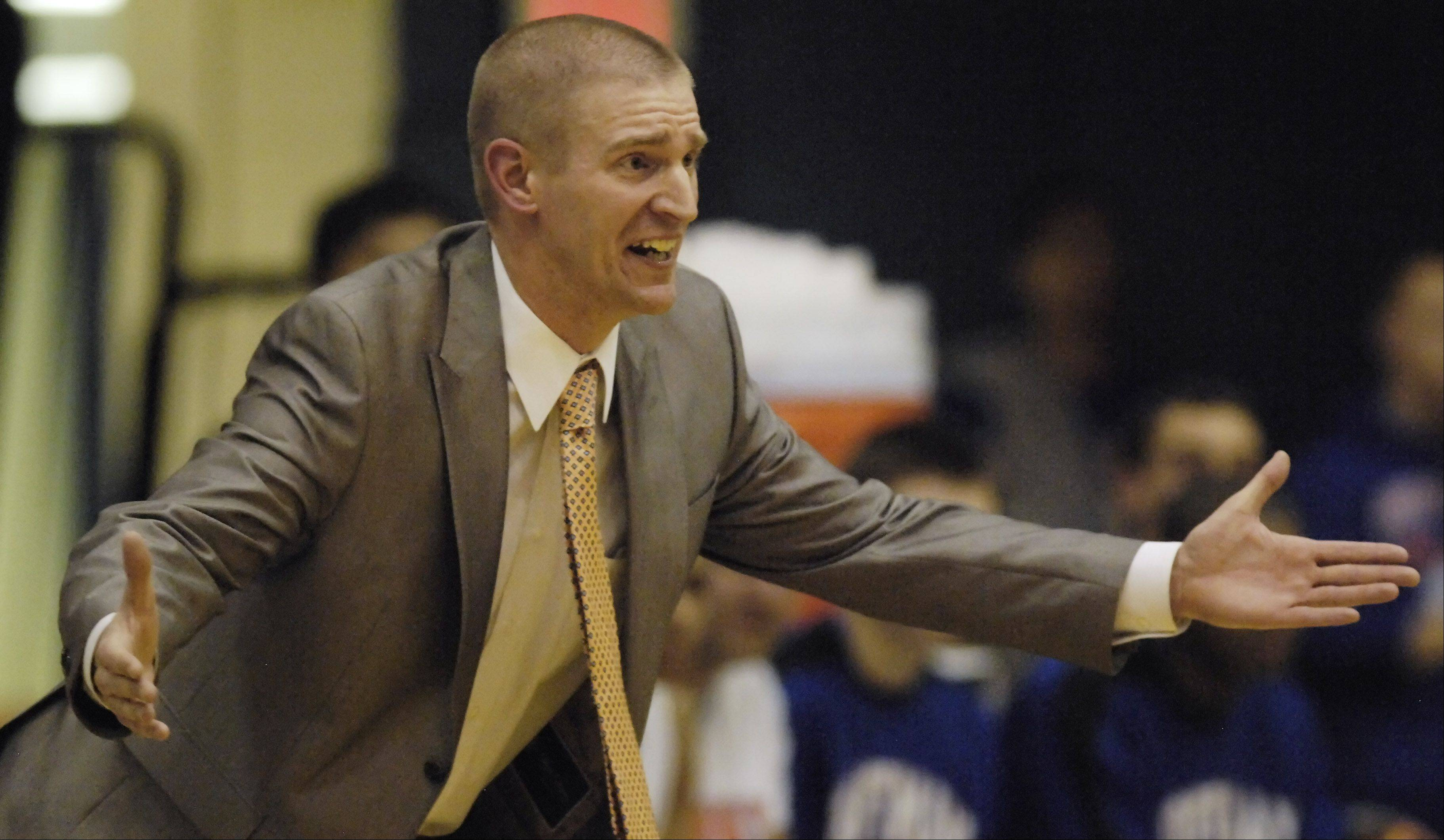 Hoffman Estates boys basketball coach Luke Yanule pleads with an official.