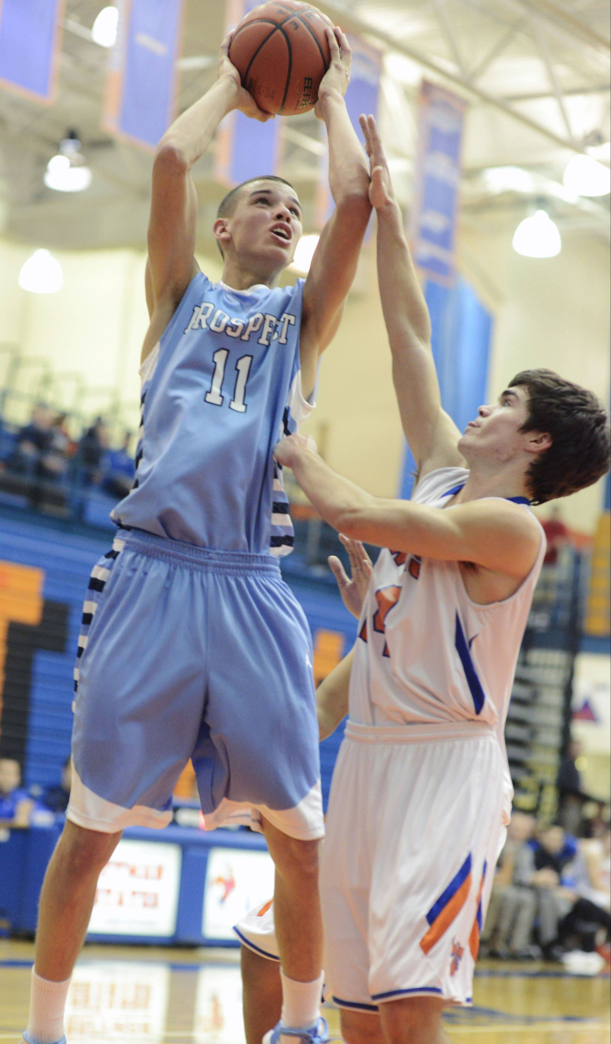 Prospect's Devin O'Hara takes a shot while being defended by Hoffman Estates' Trevor Pye during Tuesday's game.