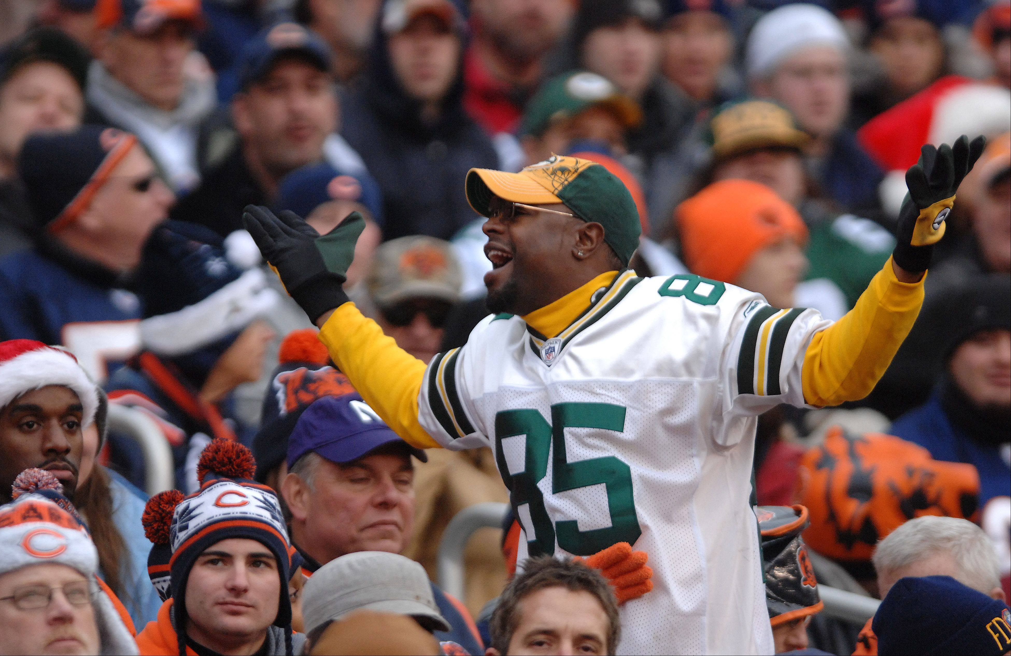 Bears fans had to sit and take it Sunday as a Green Bay Packers fan exchanges taunts at Soldier Field in Chicago. Bears linebacker Brian Urlacher, who didn't play in the game, said Chicago fans didn't get loud until they began booing the Bears.