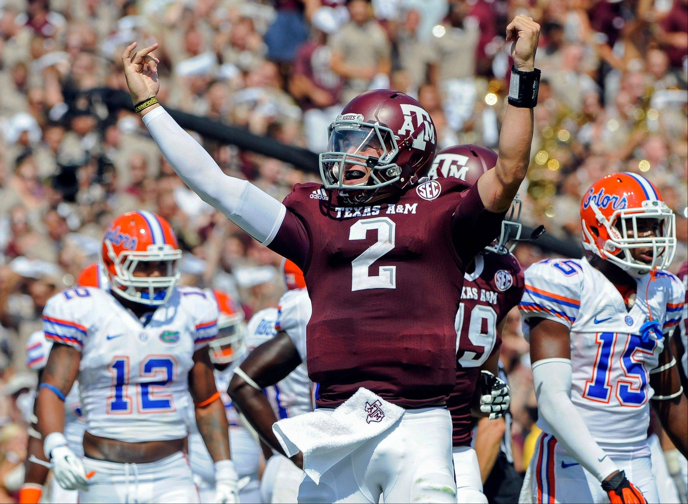 Texas A&M quarterback Johnny Manziel (2) has captured The Associated Press Player of the Year award. The freshman collected 31 votes, which were were more than twice that of second-place finisher Manti Te'o of Notre Dame.