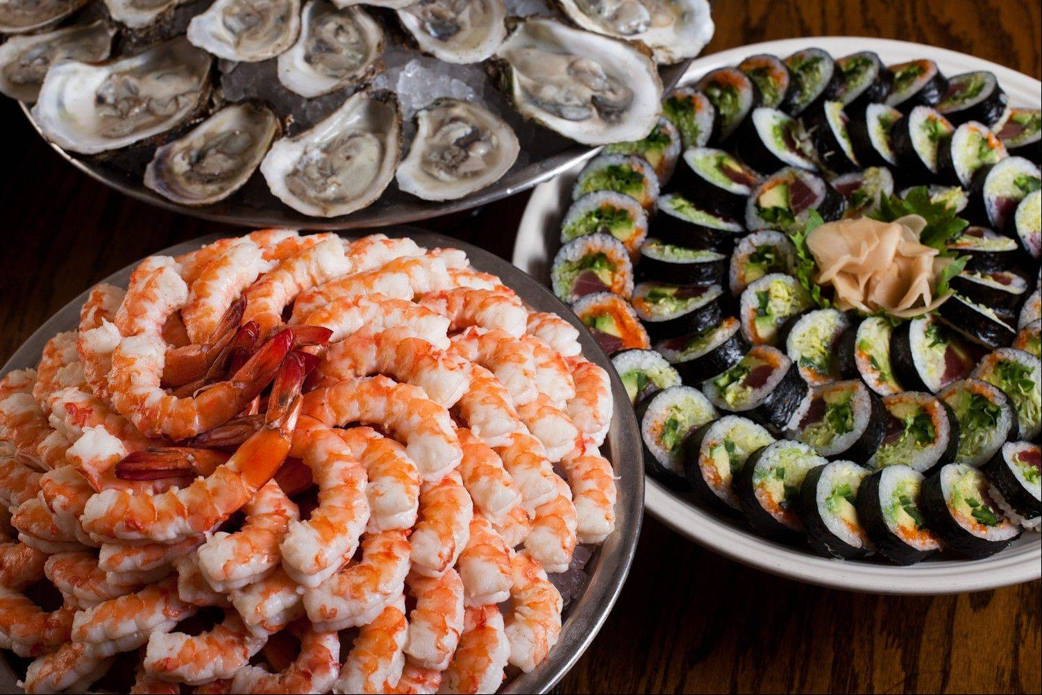 A Christmas Eve buffet at Shaw's includes both cold and hot seafood and a carving station.