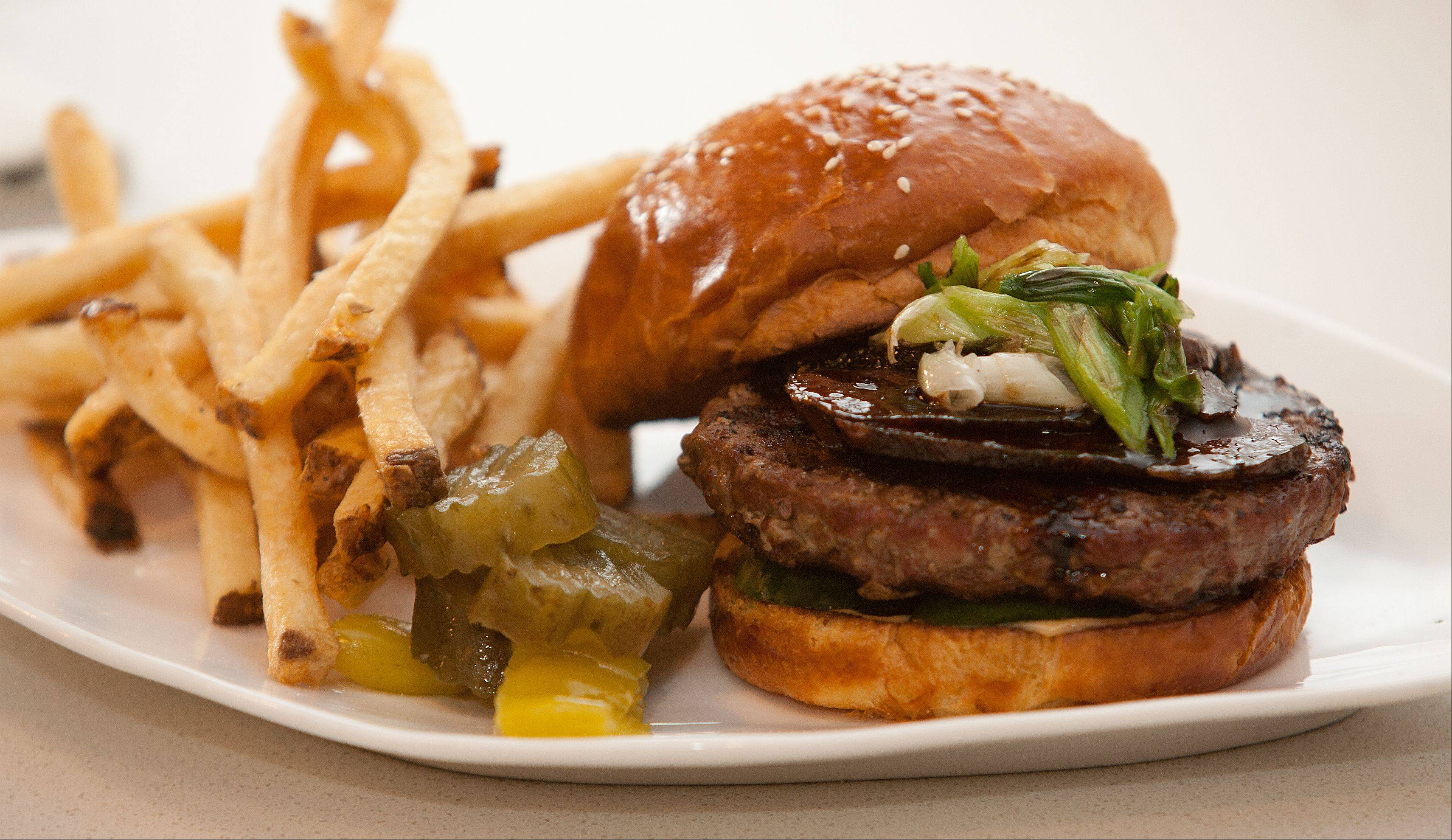 Artisan Table's hoisin burger features braised short ribs, cucumber, grilled green onion and Sriracha mayo.