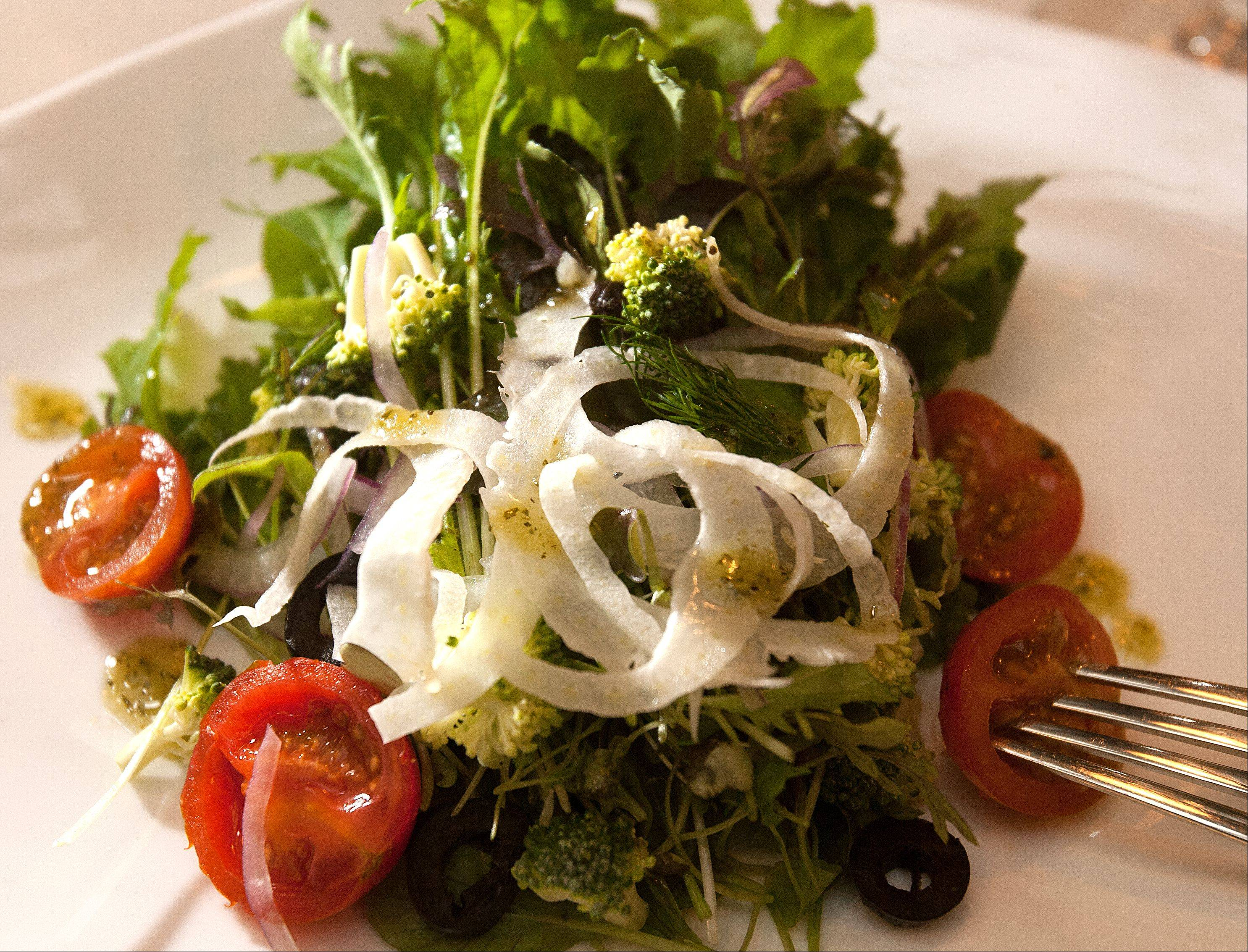 Spring greens get added flavor from fennel, celeriac, onion, broccoli and cherry tomatoes in Artisan Table's harvest salad.