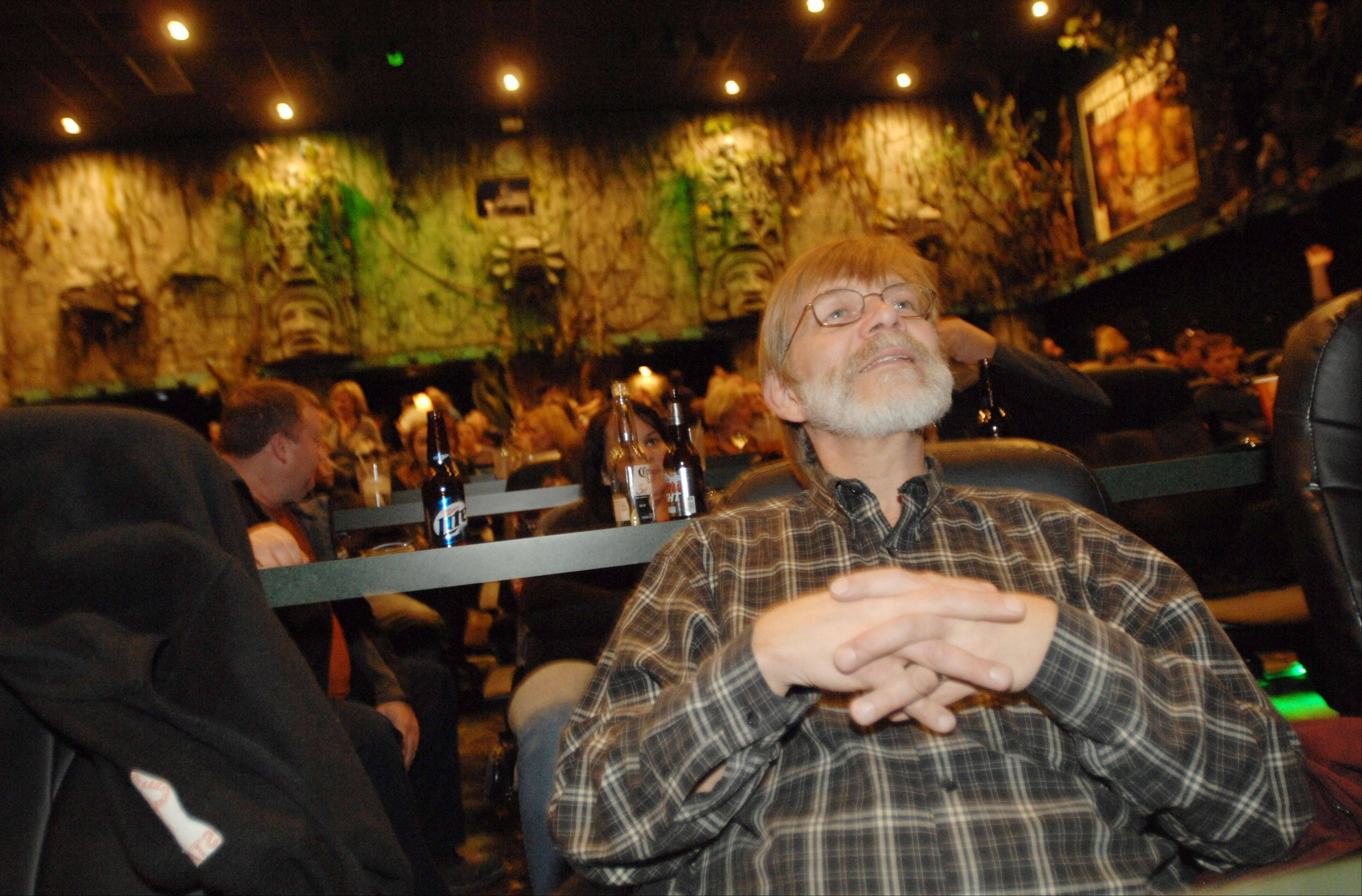 Bob Adams of Mundelein sits back and enjoys Dann Gire talk about film Tuesday at Hollywood Palms in Naperville.