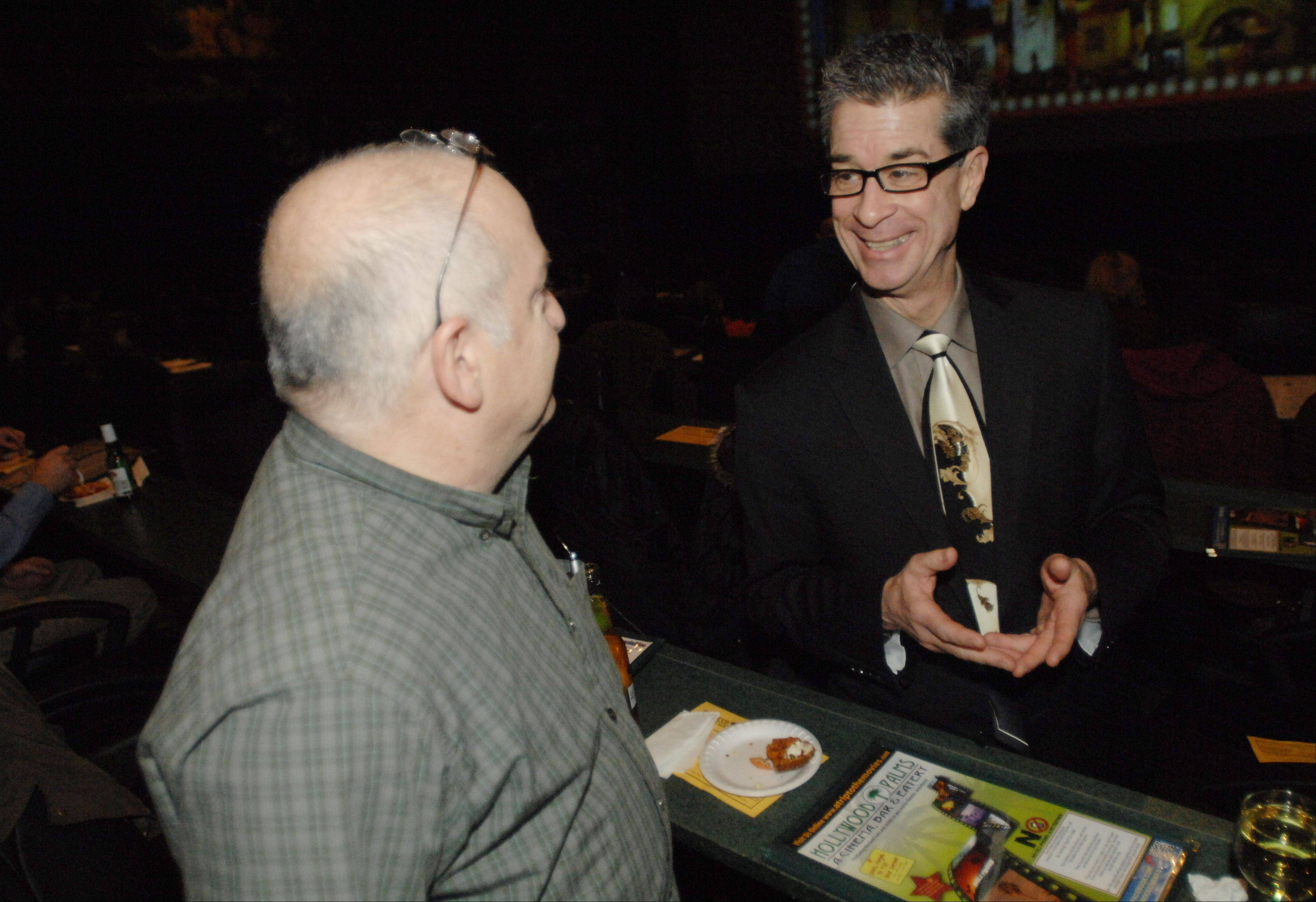 "Bob Wippman of Palatine chats with Dan Gire before Tuesday's subscribers-only screening of the new Tom Cruise film, ""Jack Reacher,"" at Hollywood Palms in Naperville. Bob mentions how he was ""eager to watch Dann on stage and talk about films."""