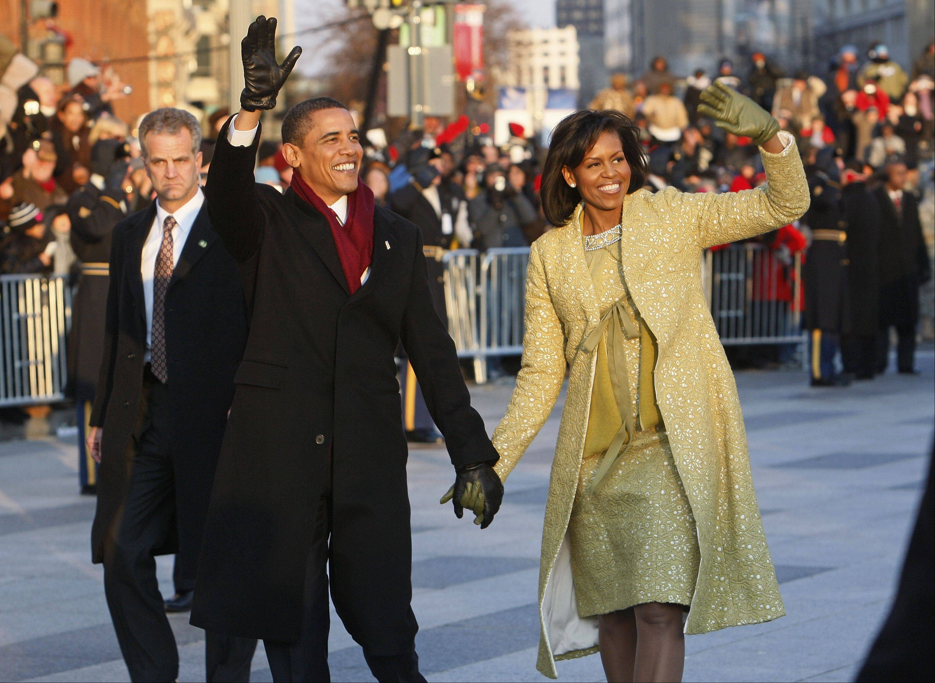 President Barack Obama and first lady Michelle Obama walked the inaugural parade route in Washington on Jan. 20, 2009.