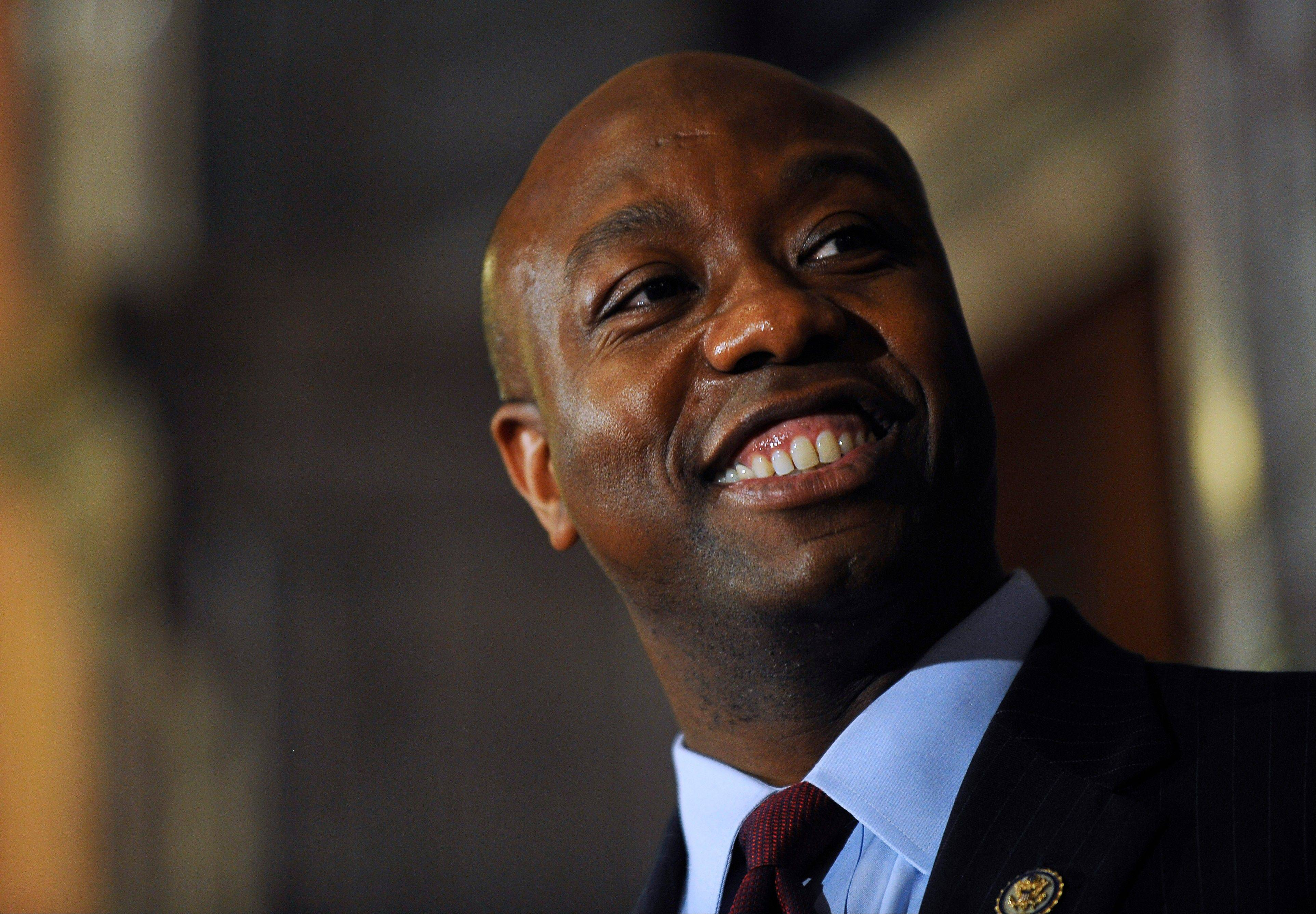 U.S. Rep. Tim Scott smiles during a press conference announcing him as Jim DeMint's replacement in the U.S. Senate at the South Carolina Statehouse on Monday, Dec. 17, 2012, in Columbia, S.C. South Carolina Gov. Nikki Haley announced Scott, as Sen. Jim DeMint's replacement, making him the only black Republican in Congress and the South's first black Republican senator since Reconstruction.
