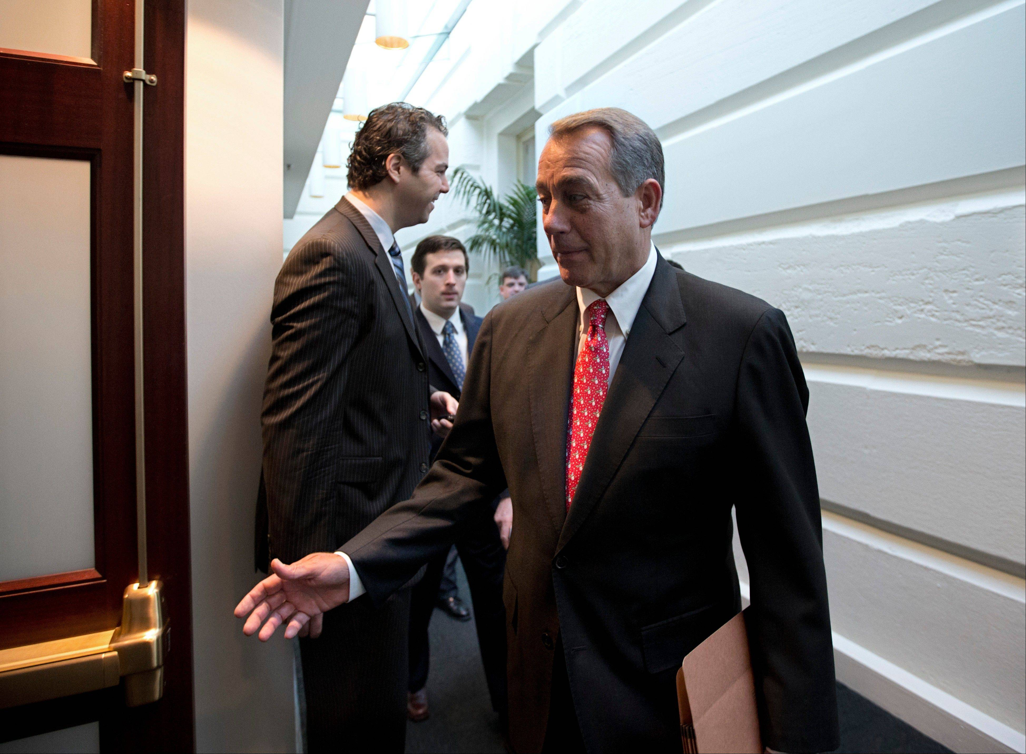 Speaker of the House John Boehner arrives for a closed-door meeting with House Republicans as he negotiates with President Obama to avert the fiscal cliff, at the Capitol in Washington on Tuesday.