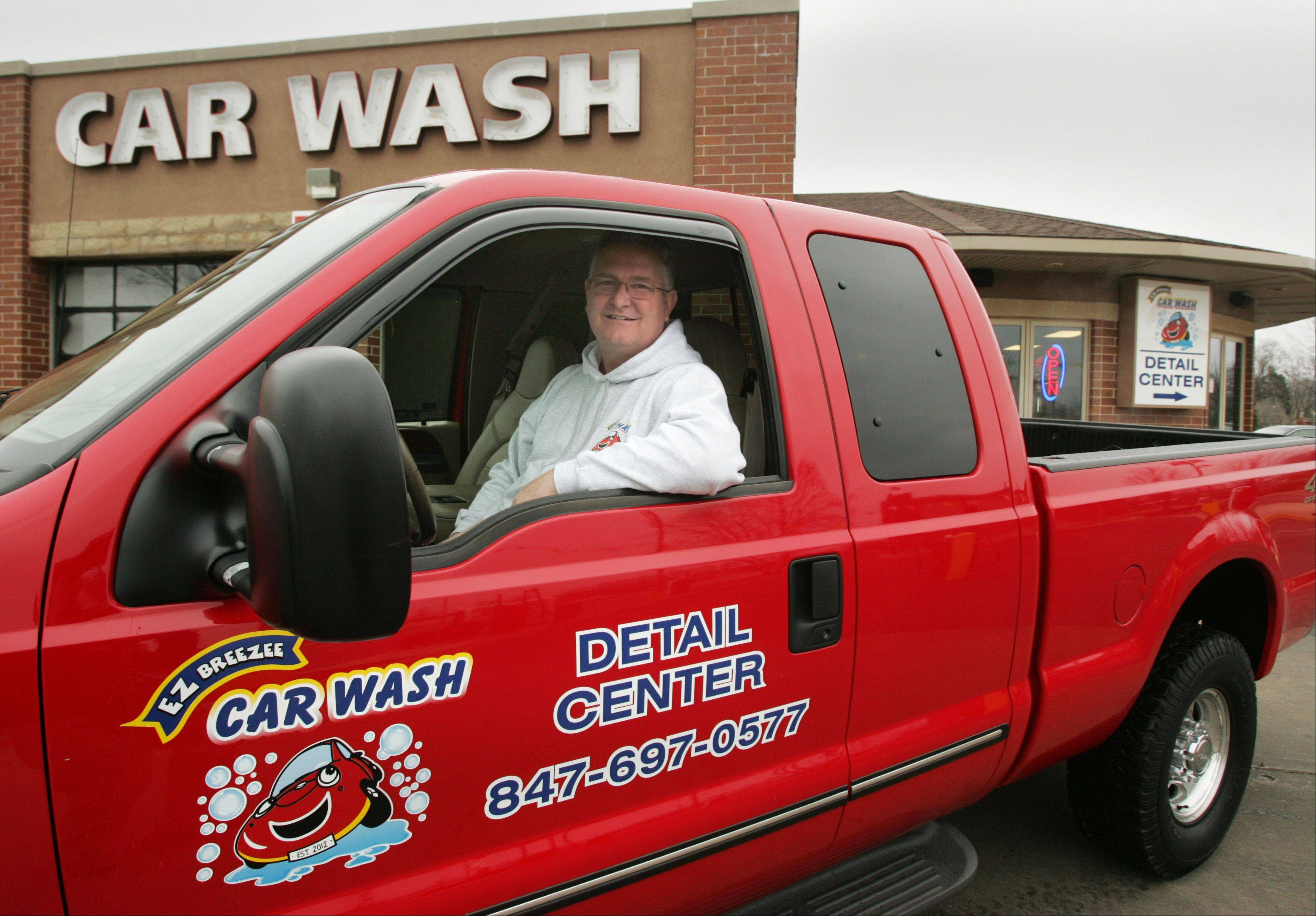Brian Harrington owns EZ Breezee Car Wash in Elgin with his wife Donna. The Harringtons have made several improvements to the business since taking over earlier this year.