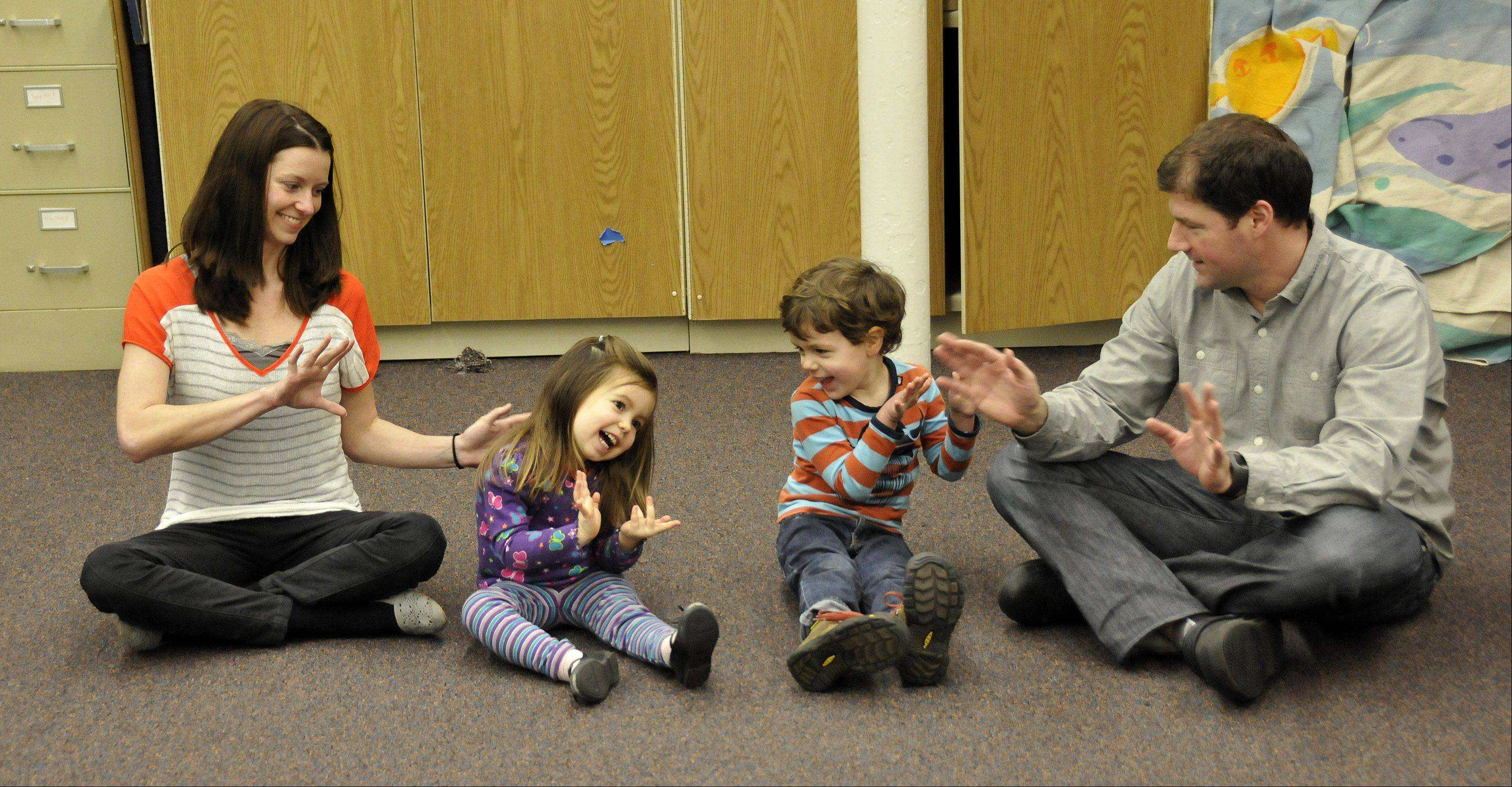 Andrea Smith, Saige Smith, Jeremiah Rodgers and Shane Rodgers sing a song during an early childhood music class at Wheaton College's Community School of the Arts. Out of 1,700 students last year, 177 were enrolled in early childhood programs.