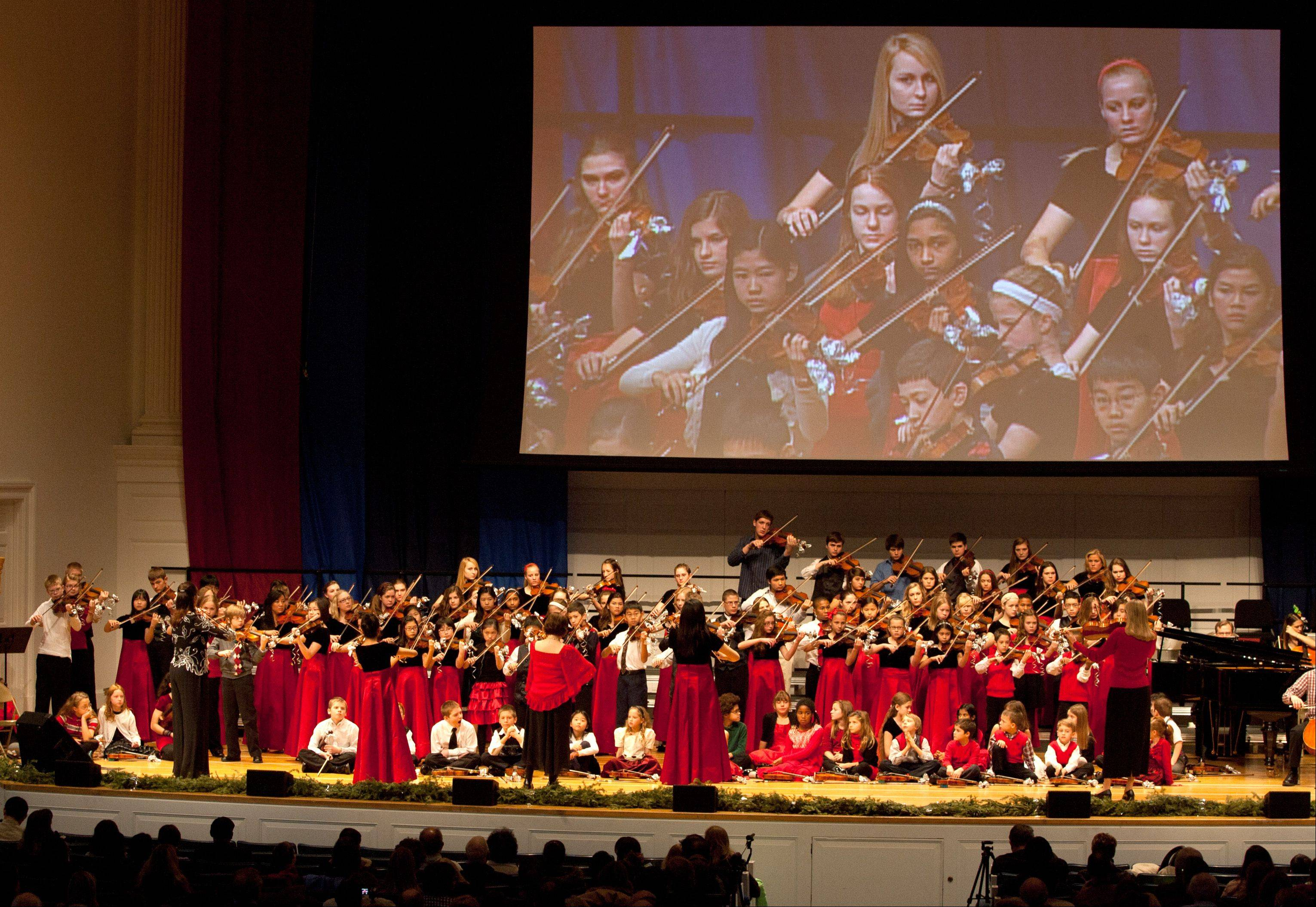 "Wheaton College's Community School of the Arts Suzuki Strings presents ""The Spirit of Christmas."" The arts and music festival Dec. 15 showcased the talents of 170 Suzuki and visual arts students."